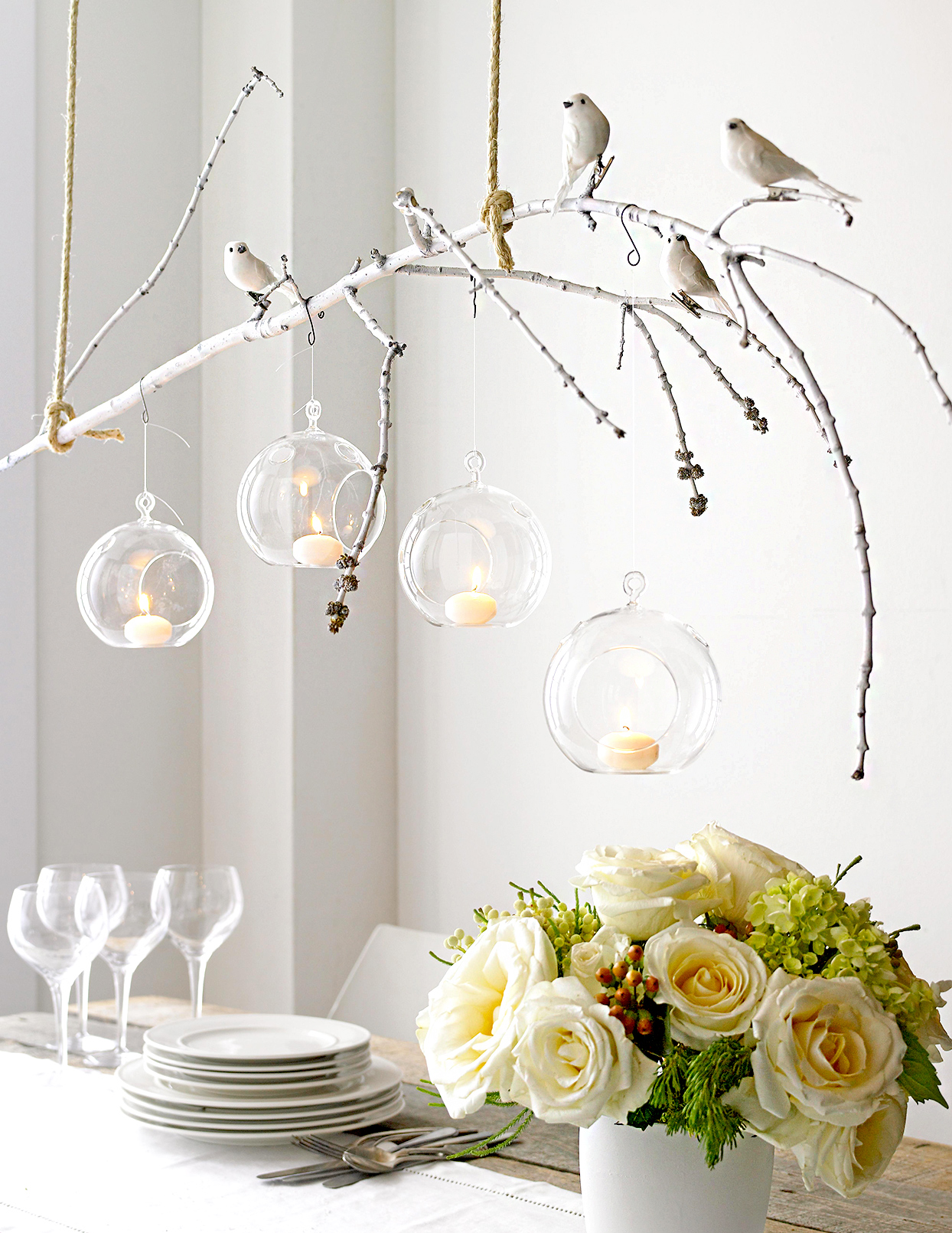 Branch with birds and glass with candles