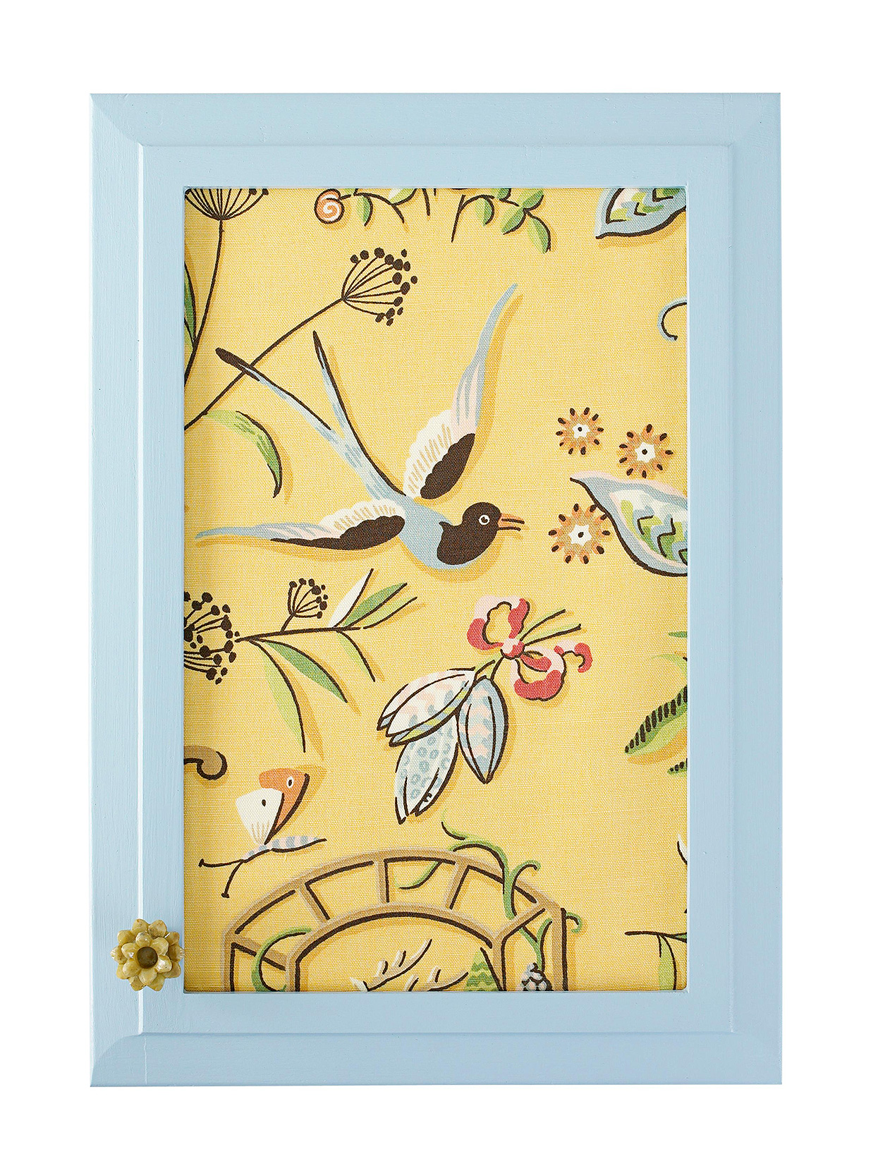 pale blue cabinet door with vintage bird-themed wallpaper inset