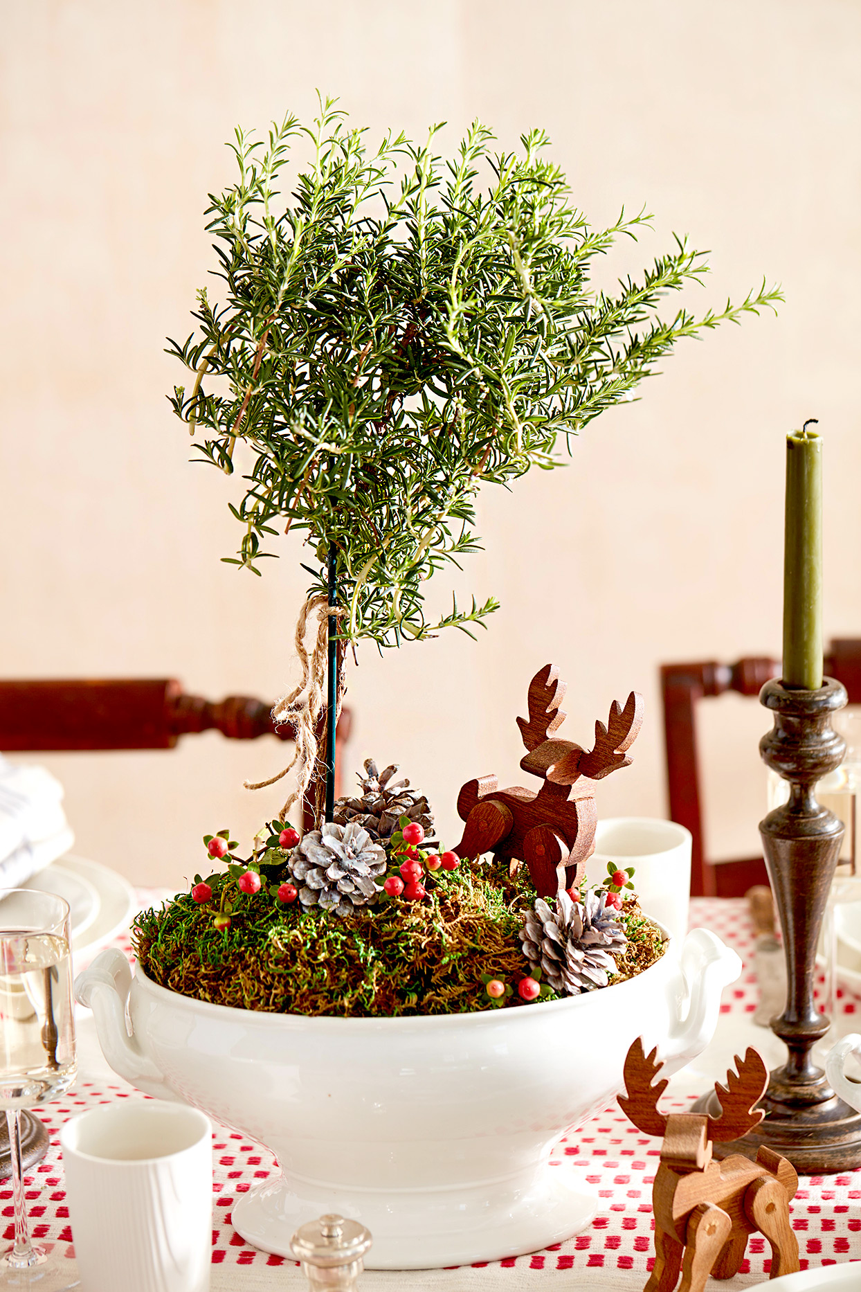 Centerpiece with tree, pinecones, and deer