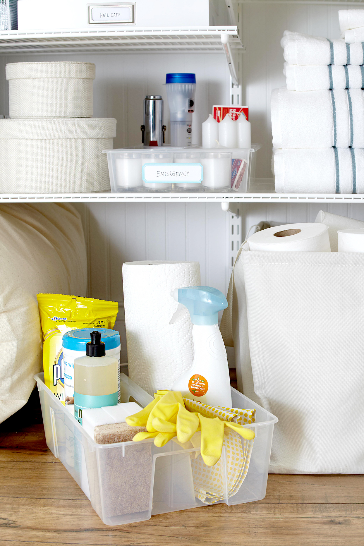 Cleaning supplies stored under shelf