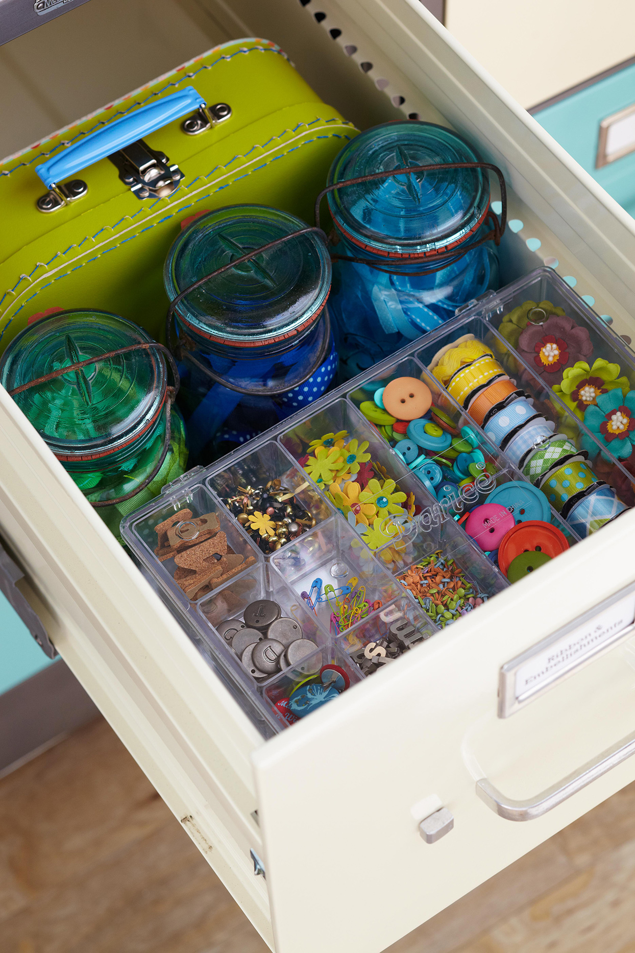 drawer of crafting supplies in mason jars