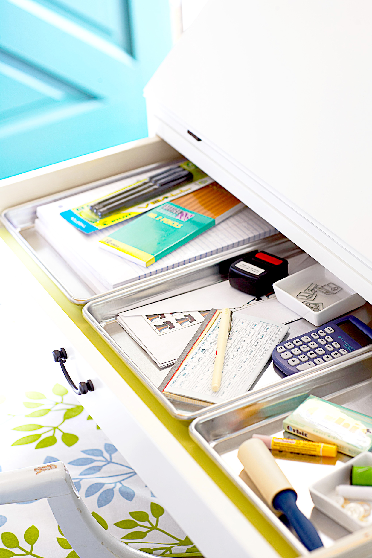Drawer with metal trays filled with items