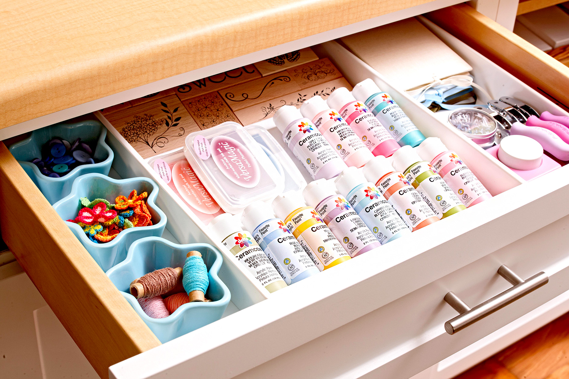 Drawer filled with organized supplies