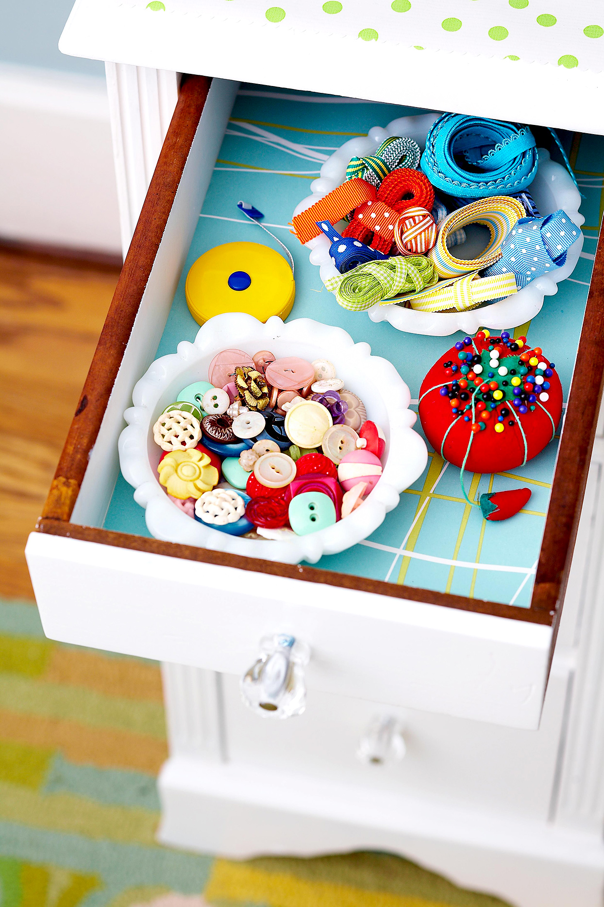 Drawer with sewing supplies in bowls