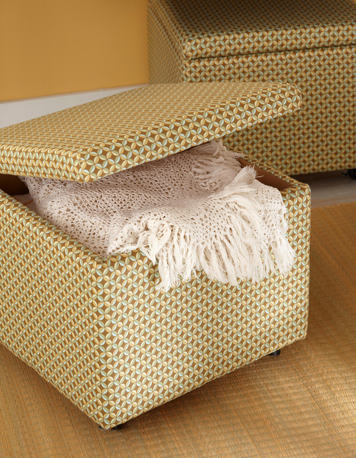 patterned fabric storage box with white blanket