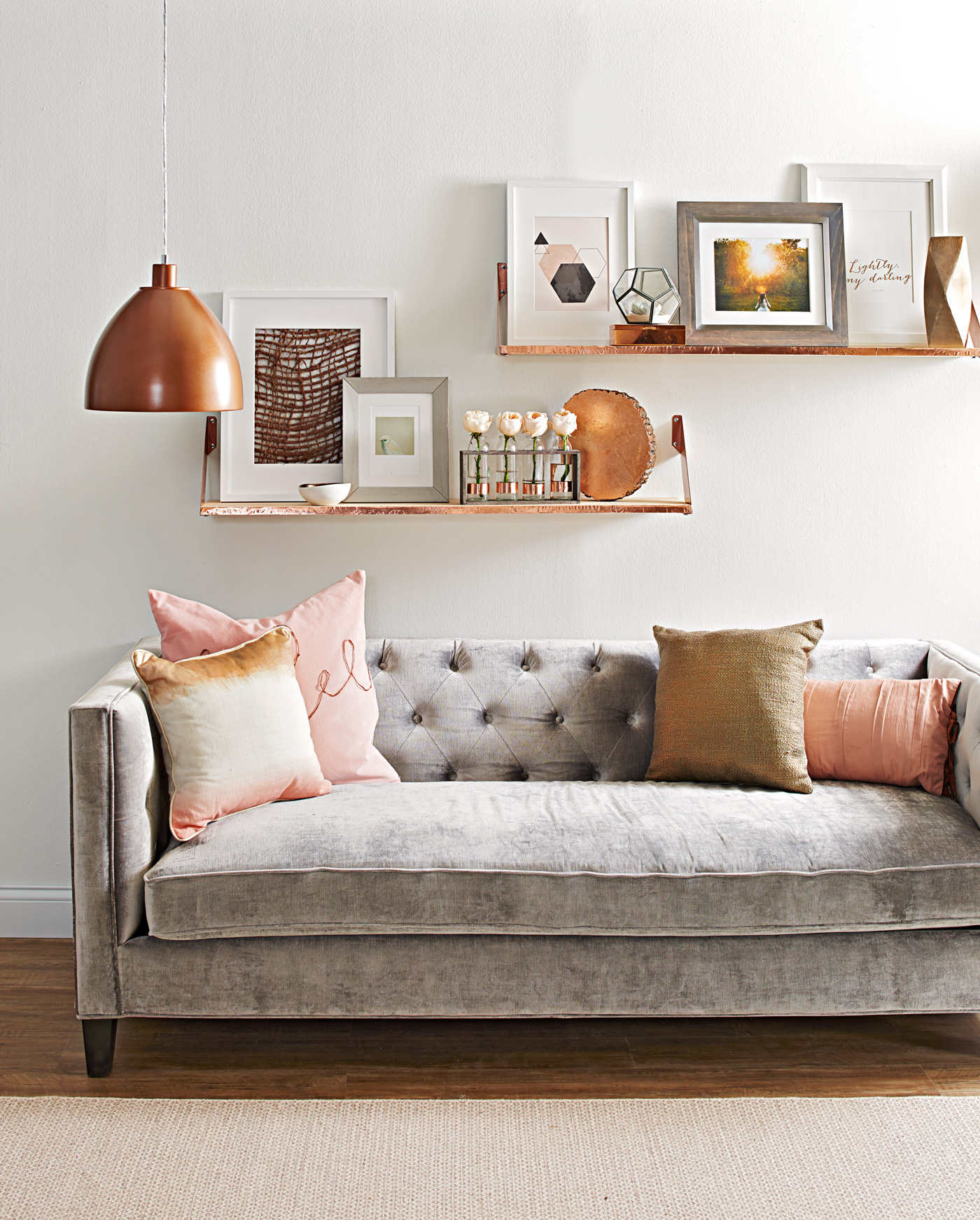layered shelves above copper and rose gold décor