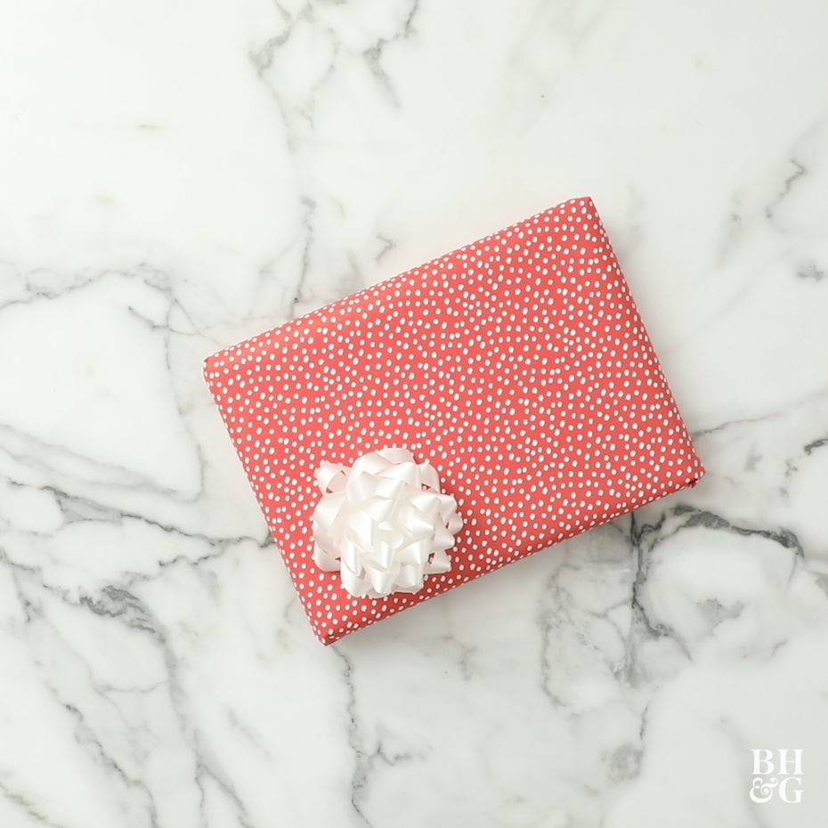 red and white present on marble background
