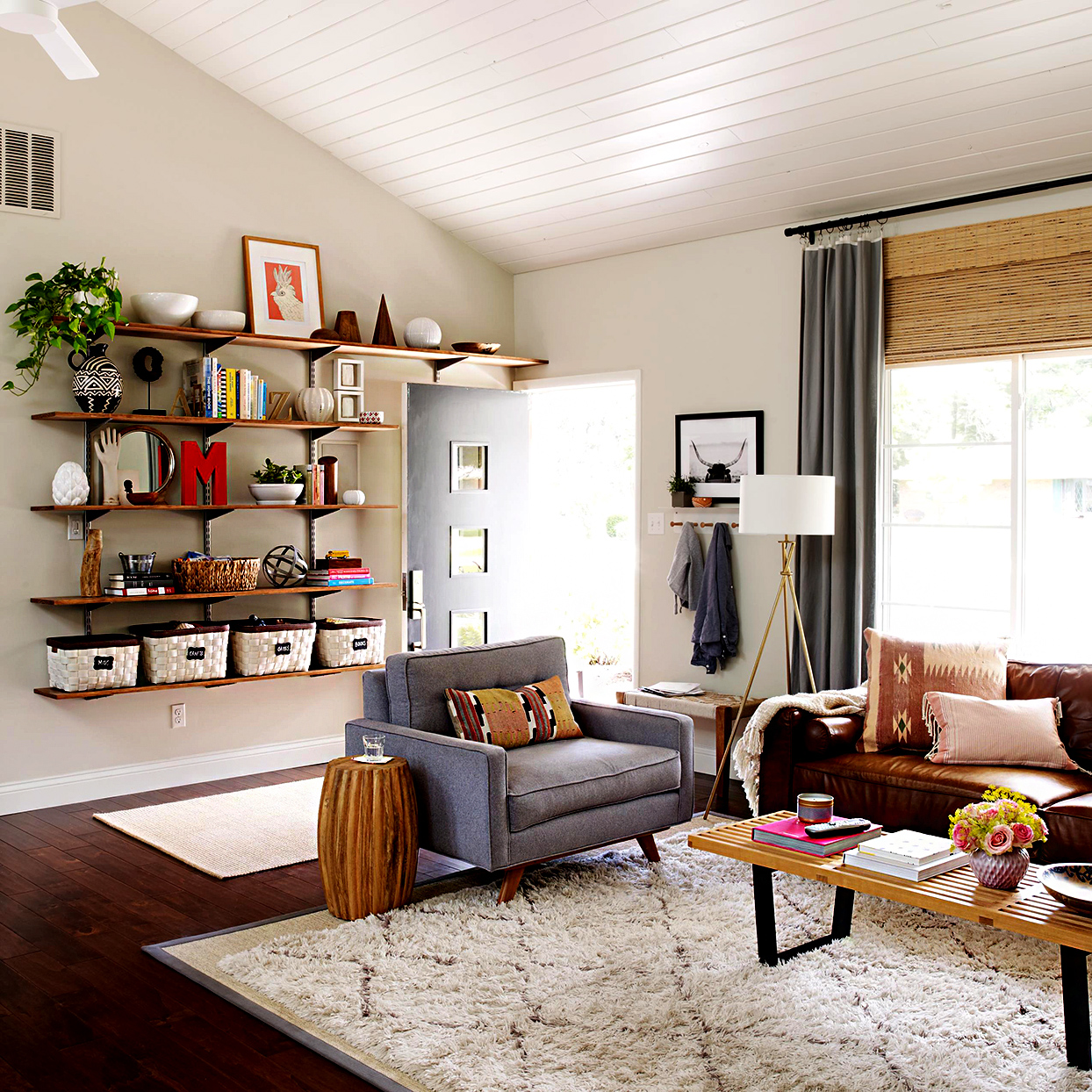 Living room with wooden shelves filled with décor