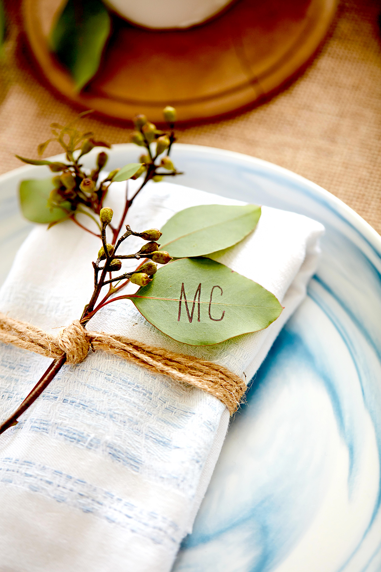 Place setting with name on leaf