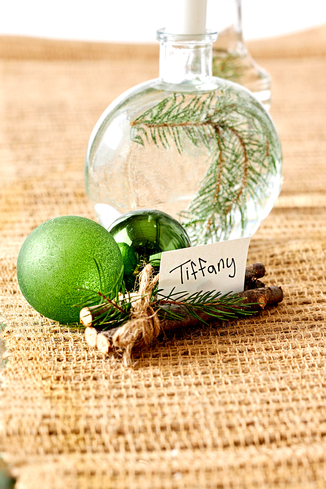 Place setting with ornament and branches