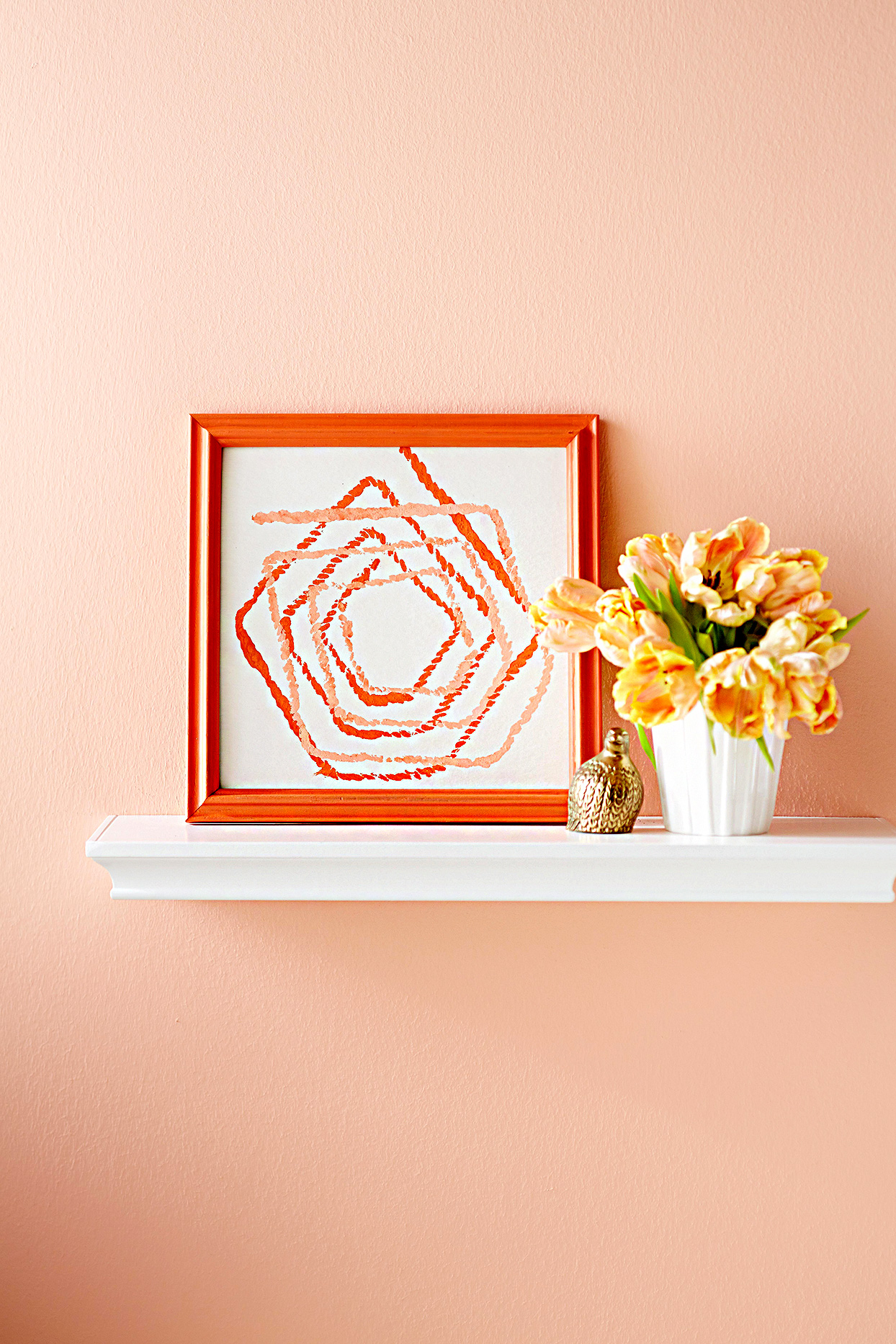 Shelf with orange stamp art
