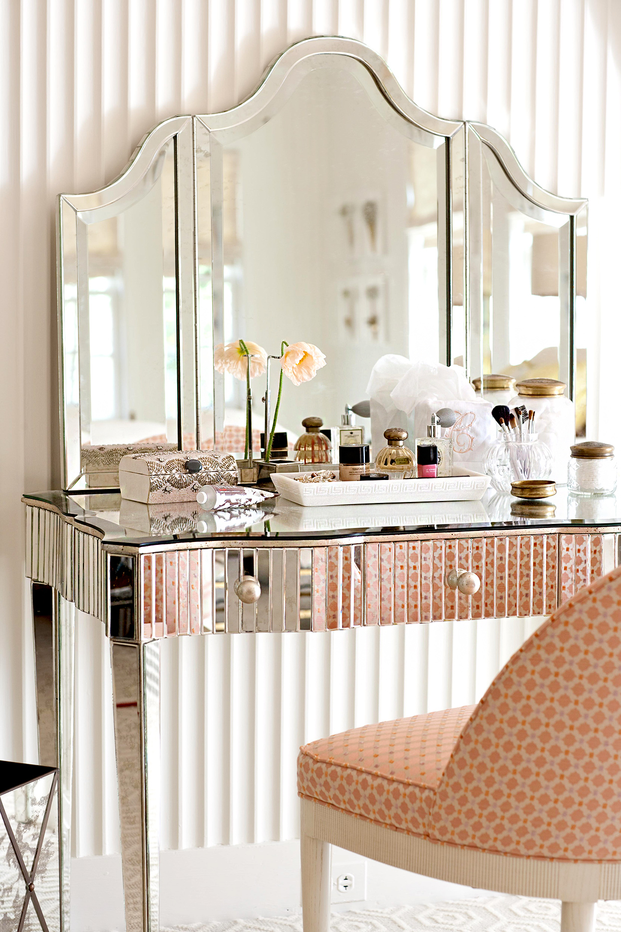 Vanity with pink accents and chair