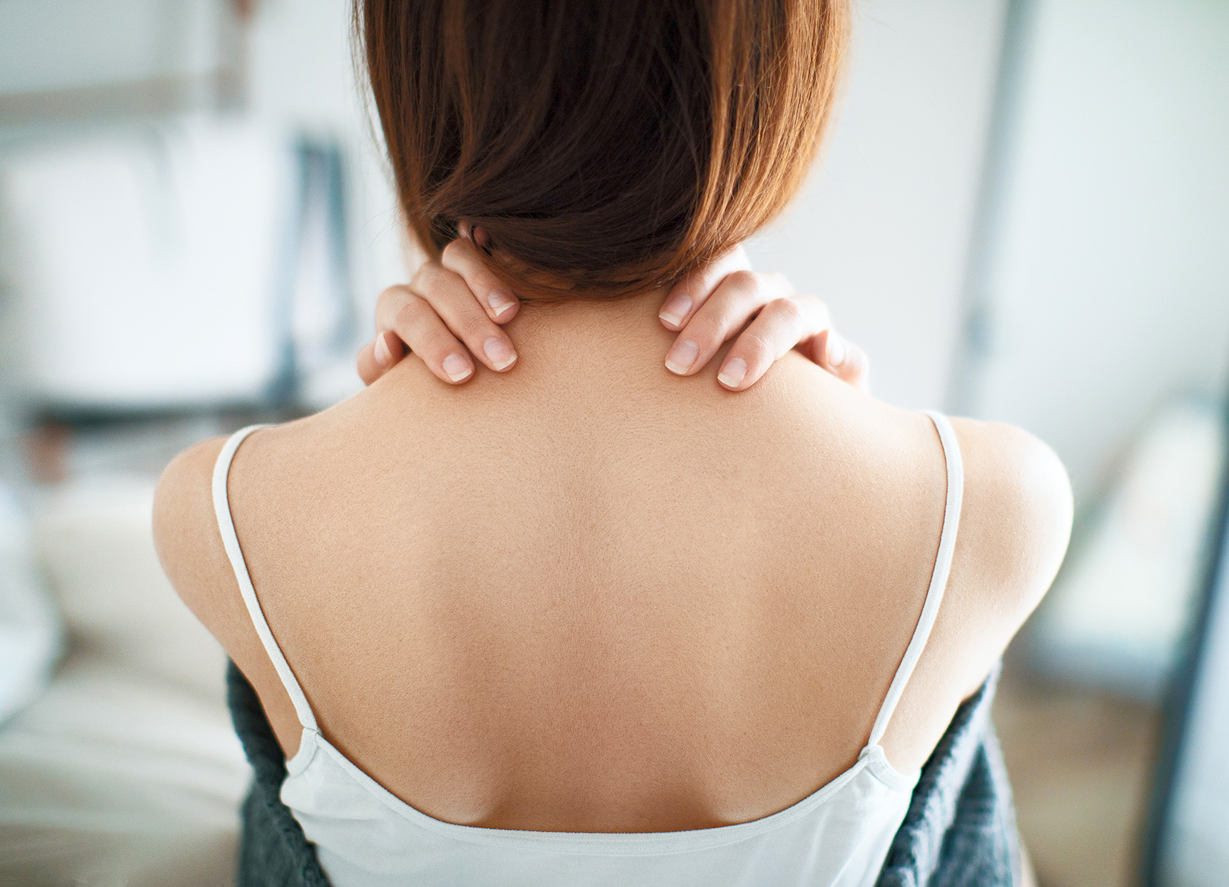woman with hands on back