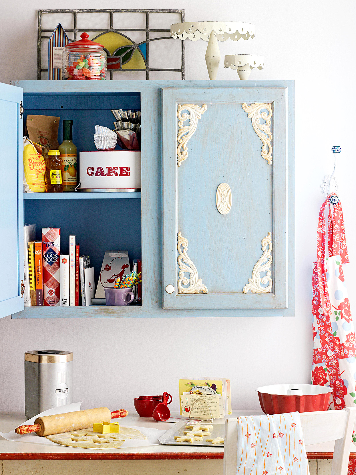 baby blue distressed cottage cabinets with ivory wooden appliques