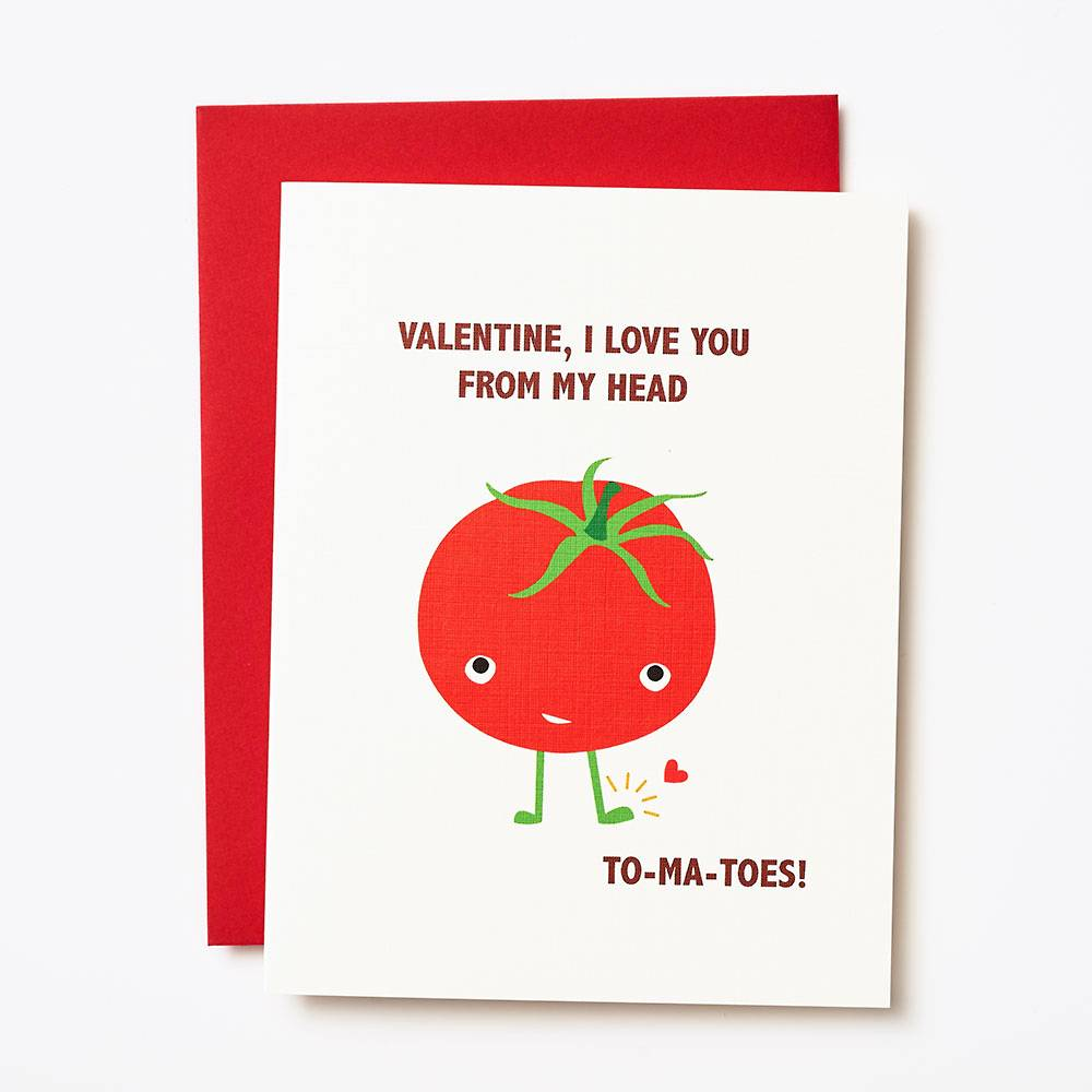 white card with red illustrated tomato on the front
