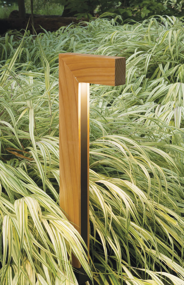 L shaped wooden outdoor light in greenery