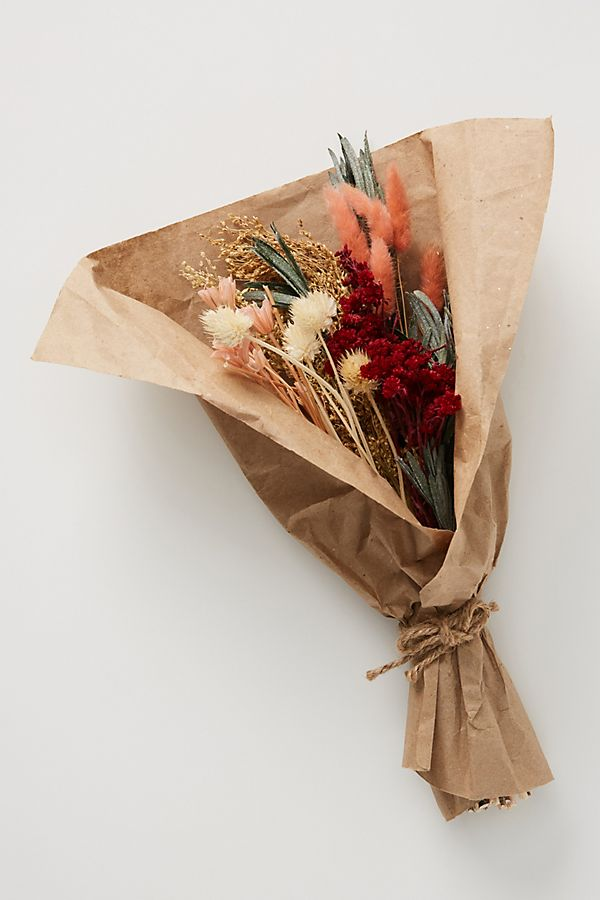 dried pink, peach and purple flowers wrapped in brown paper