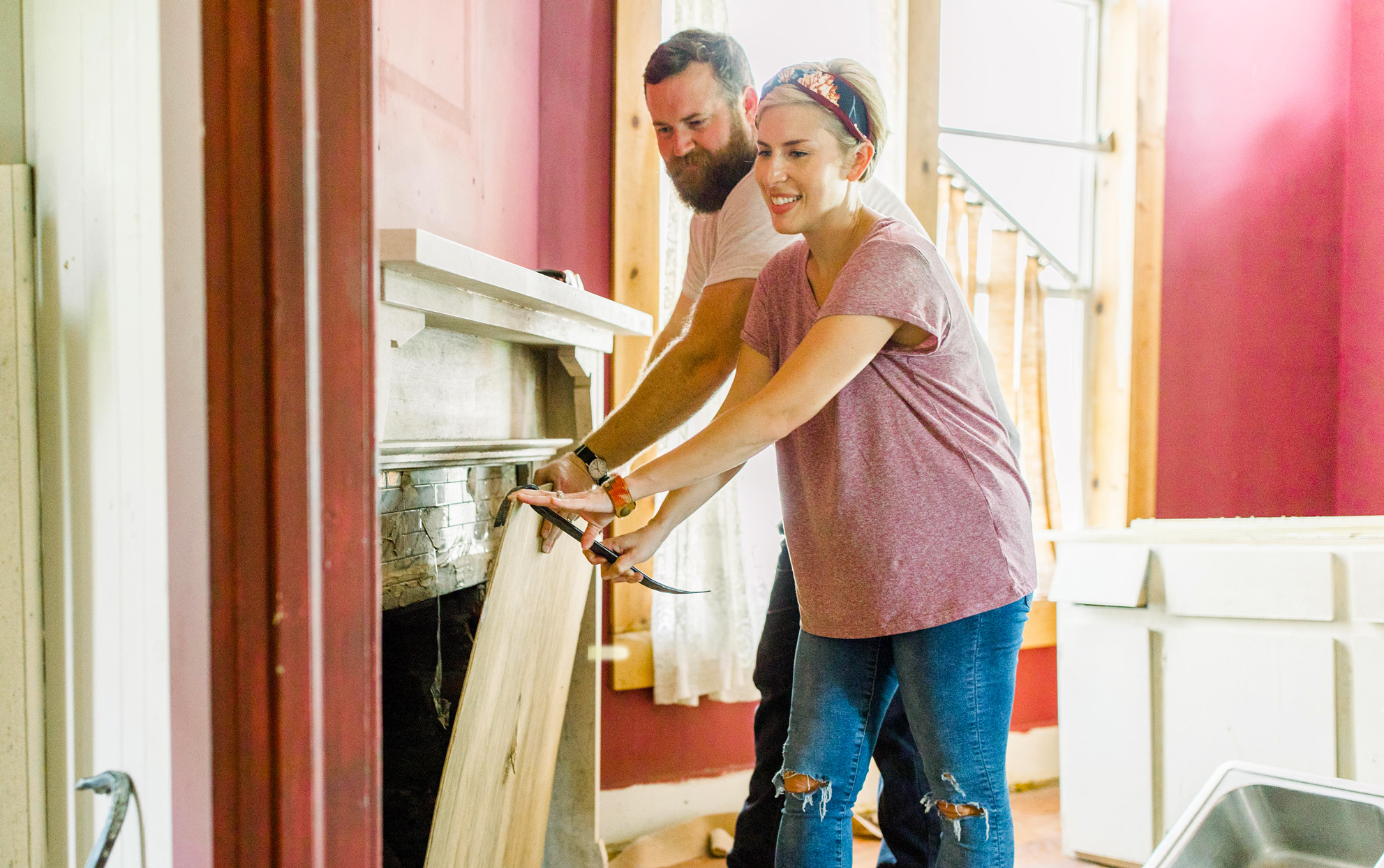 Erin and Ben Napier of HGTV's Home Town working on a home