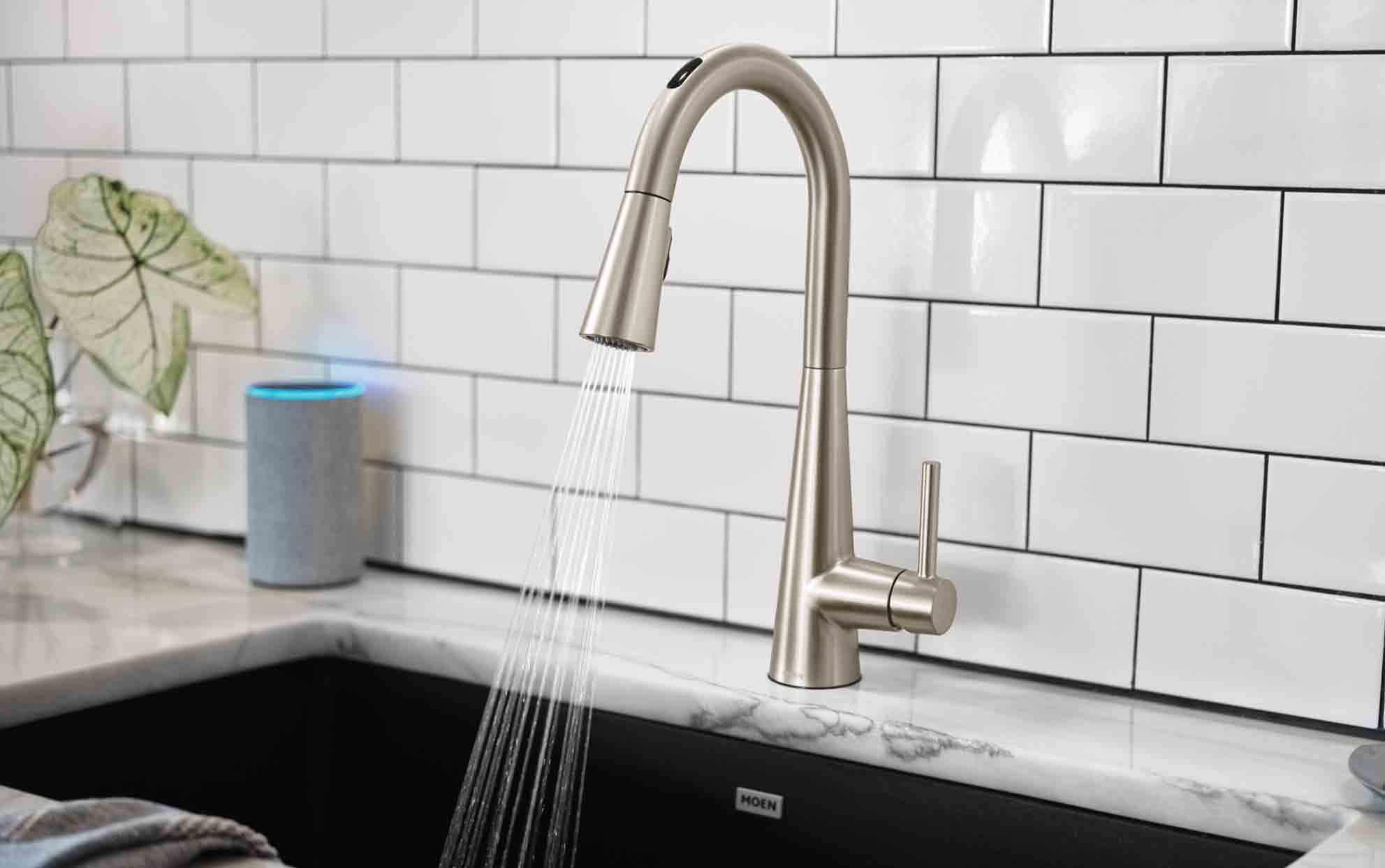 U by Moen Smart Faucet in Sleek, Spot Resist Stainless with water spraying.