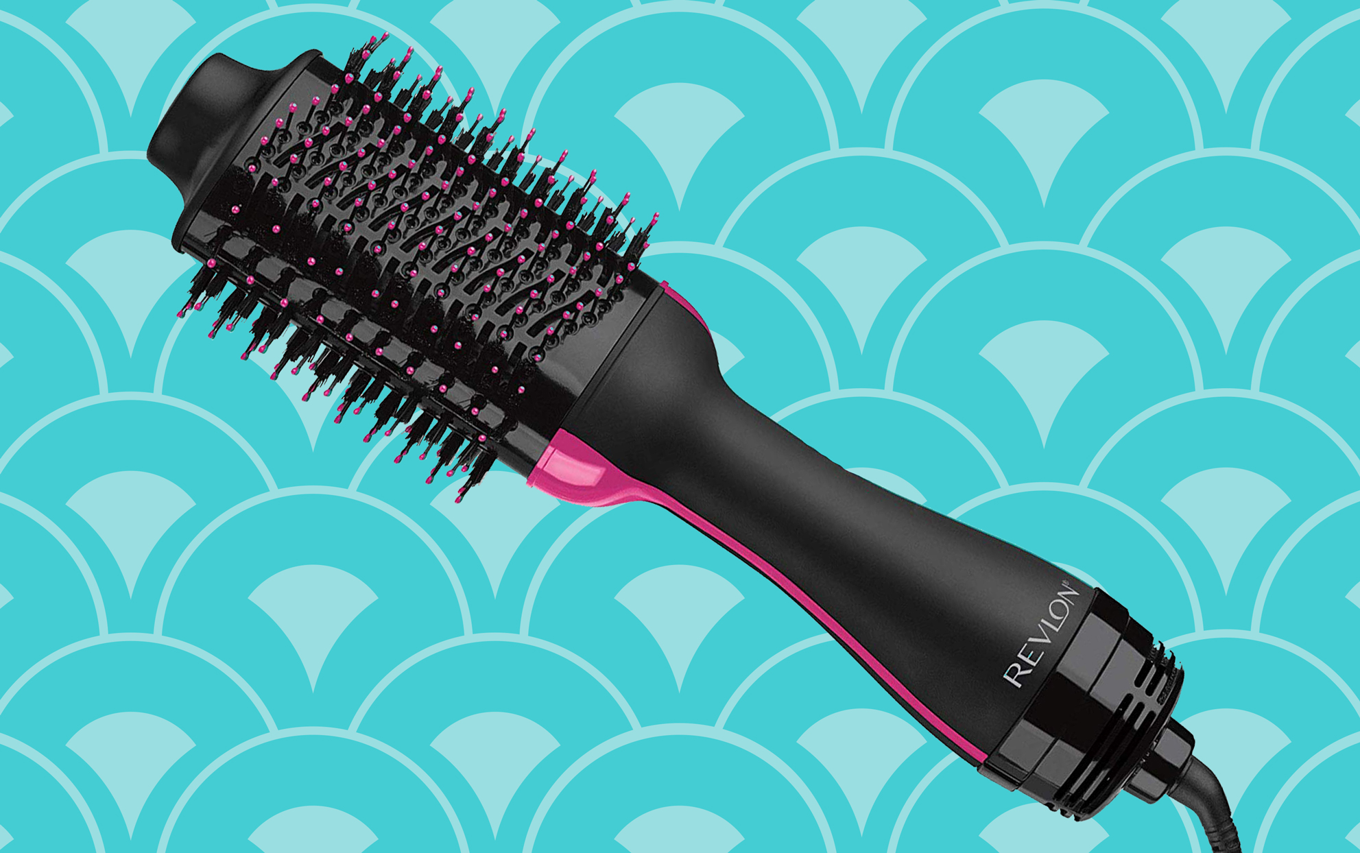 black and pink hair brush dryer on a blue background