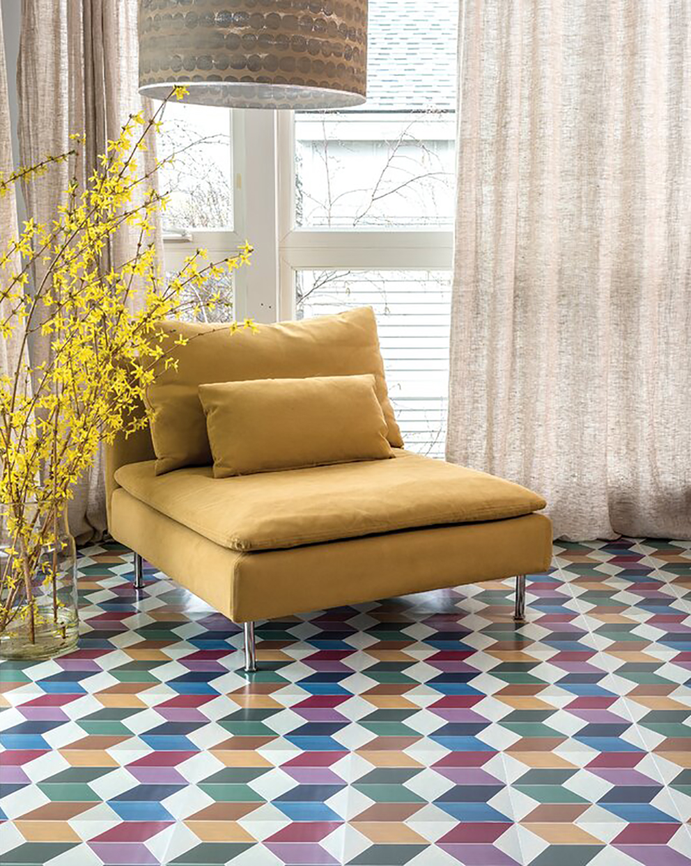 multicolored peel and stick tile floors with yellow chair and plant