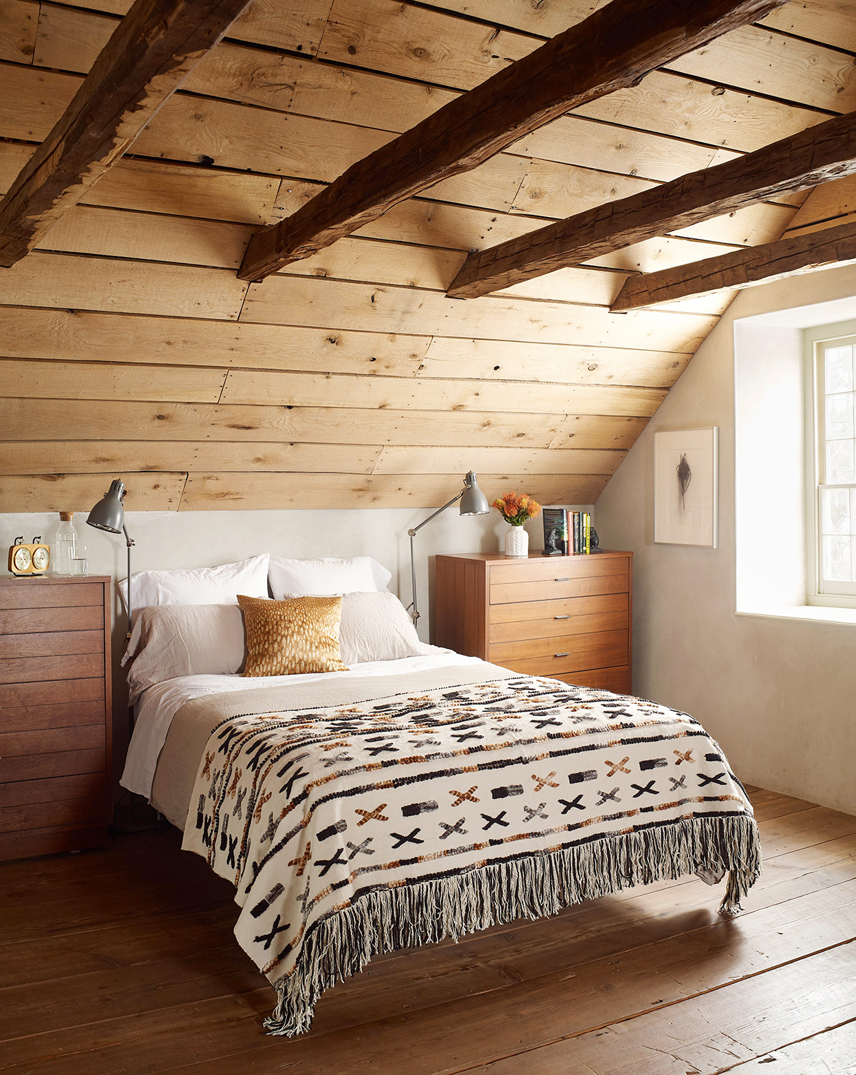 attic bedroom with wooden ceiling