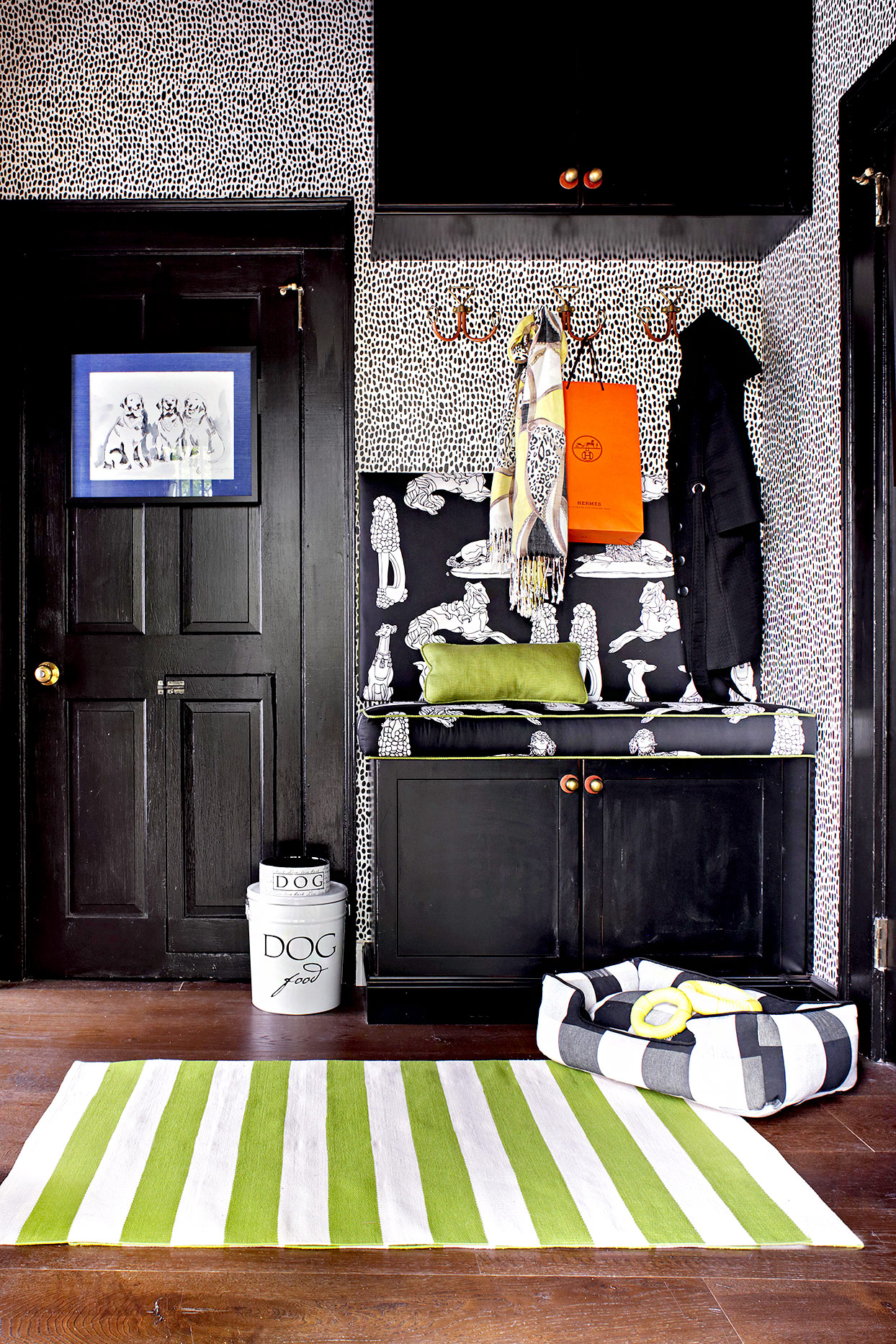 Black cabinets and patterned wall paper with dog accessories