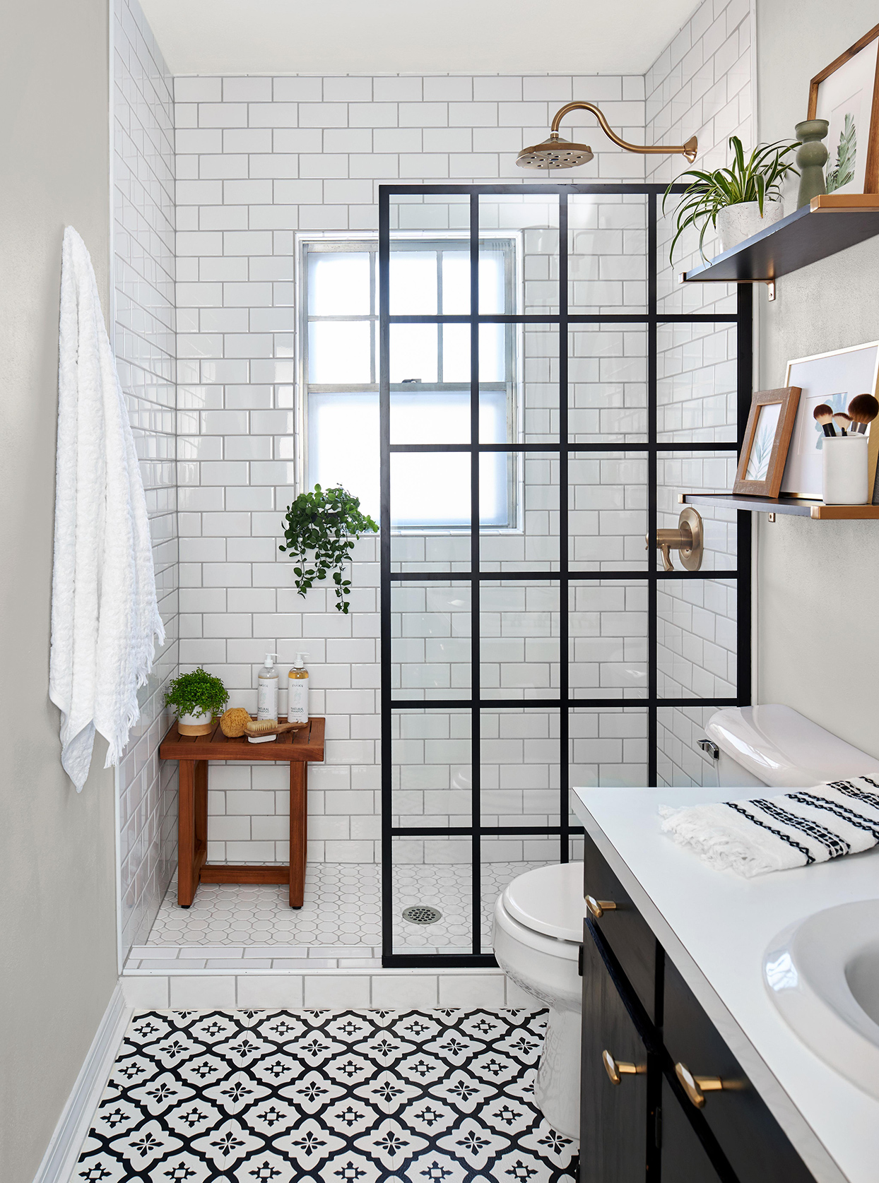 black and white modern bathroom with plants