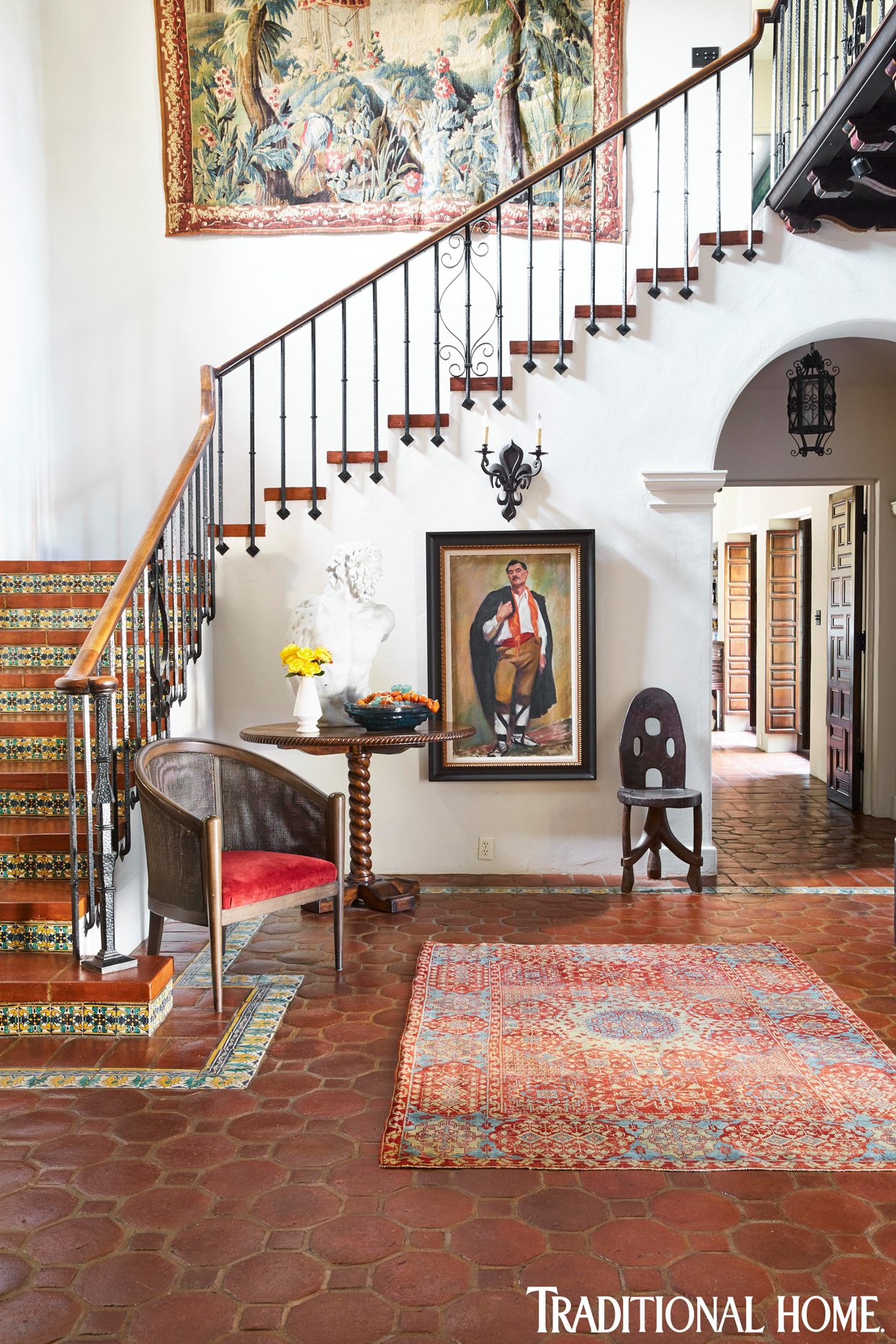 spanish colonial entryway with staircase