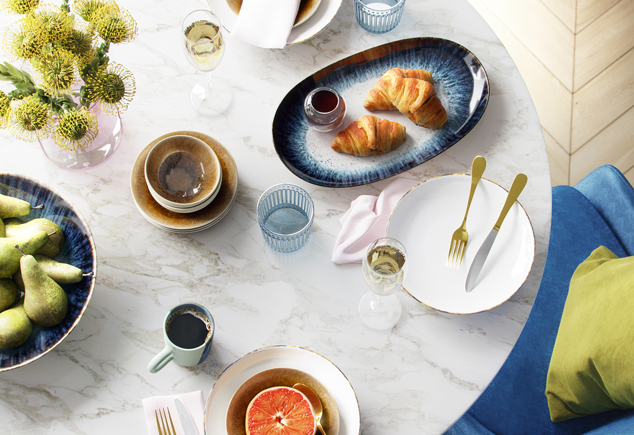 marble table with dishes and glassware