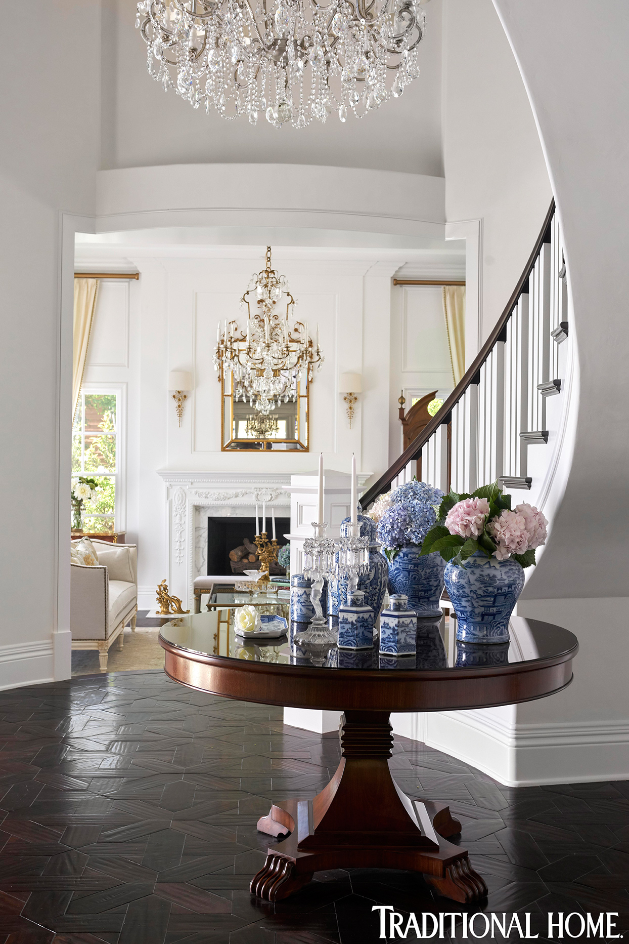 elegant white and dark wood entryway