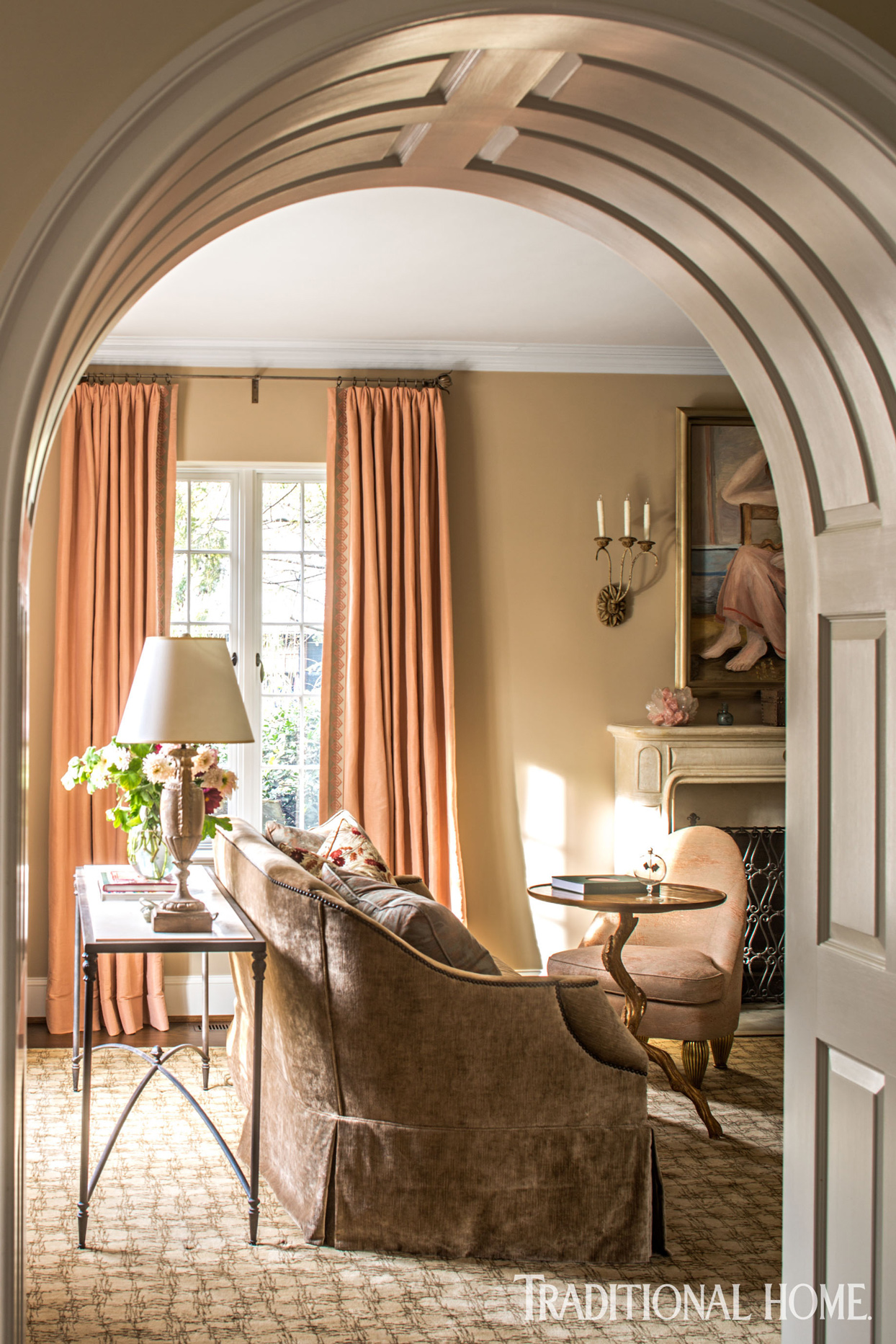 tudor home with rounded living room archway