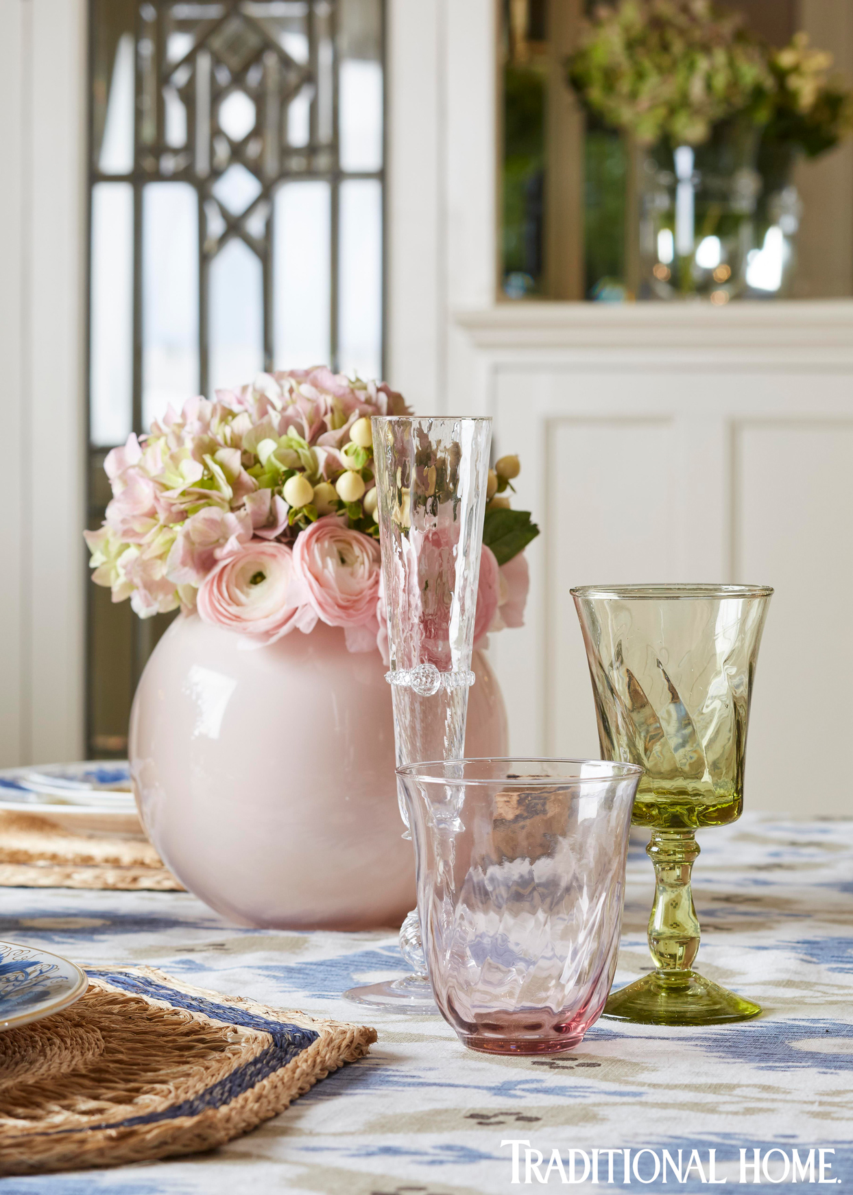 three pastel pink and green glass receptacles