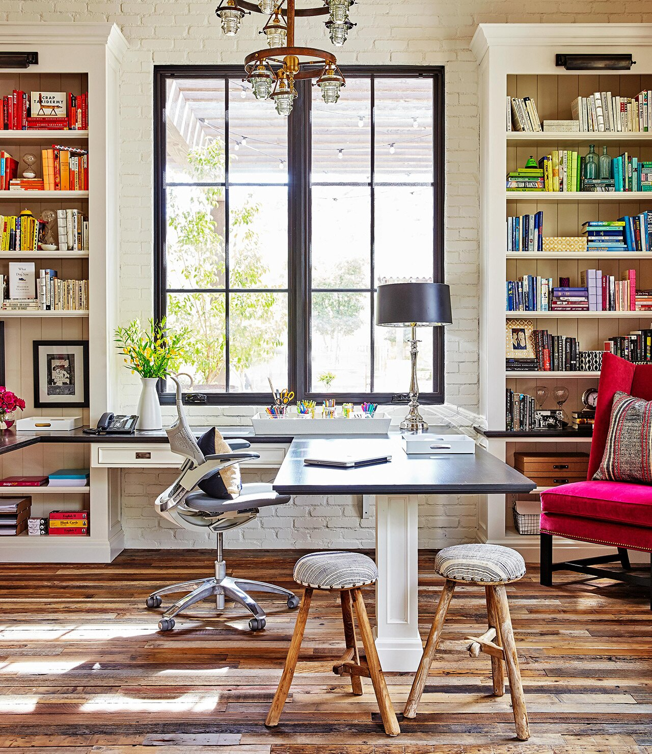 home office near window with white bookcases
