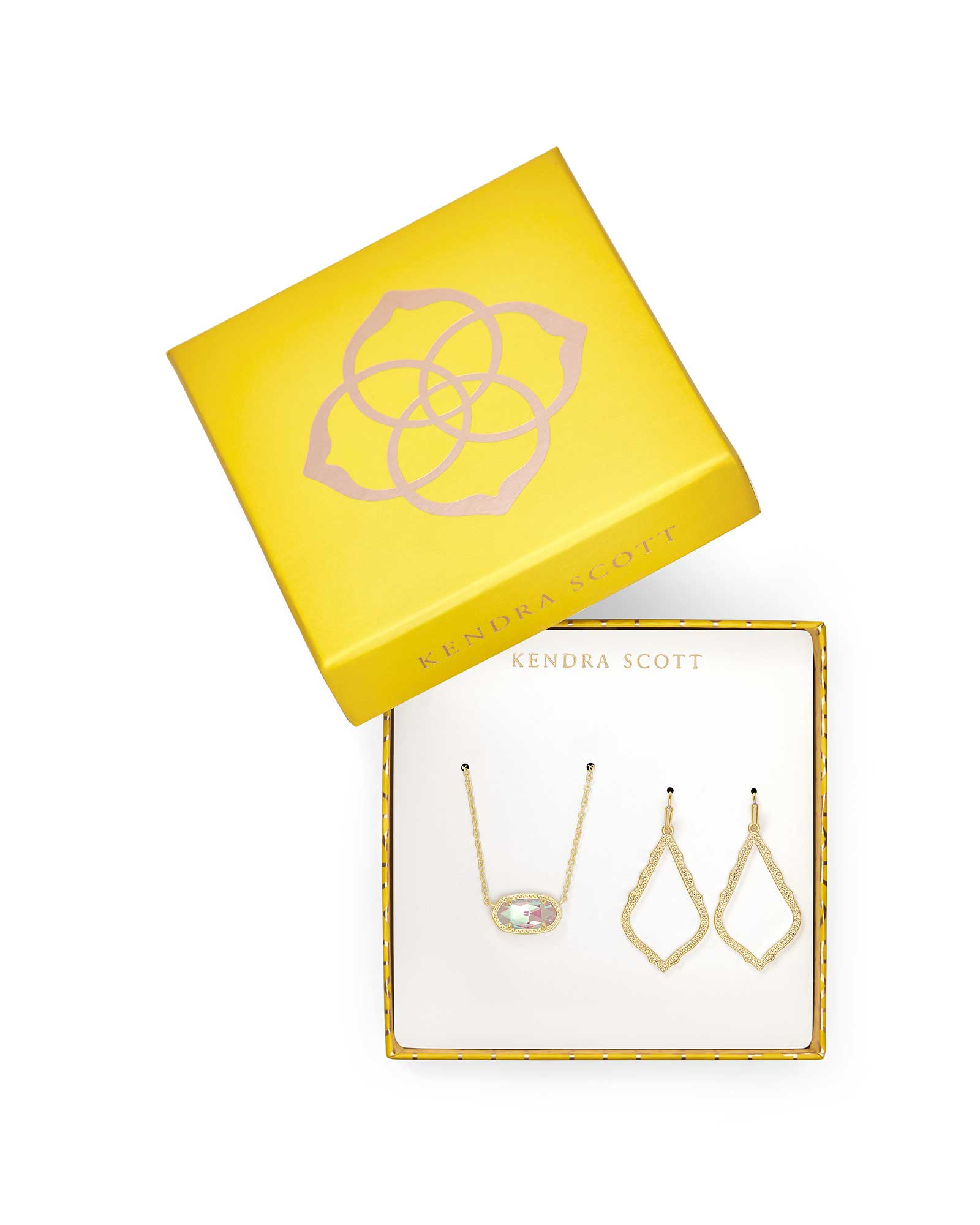 gold necklace and earrings in yellow box