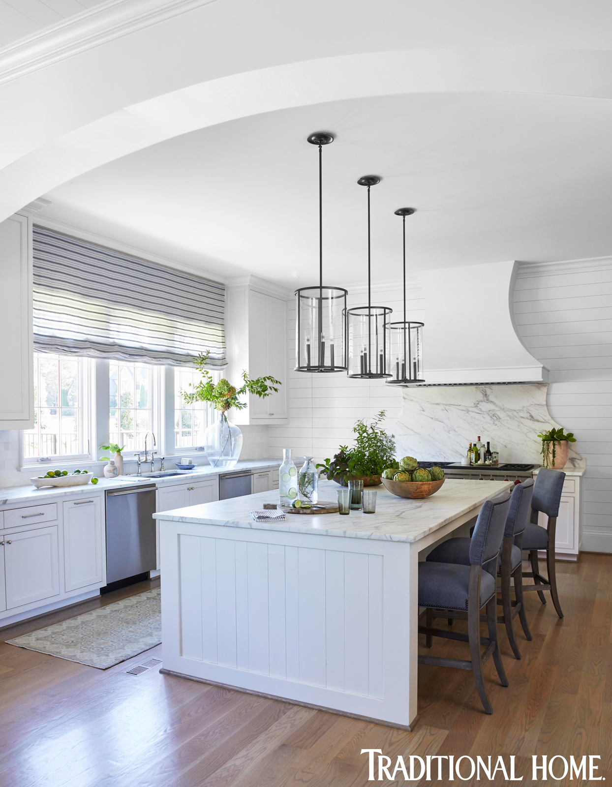 blue and blue kitchen with arching high ceiling