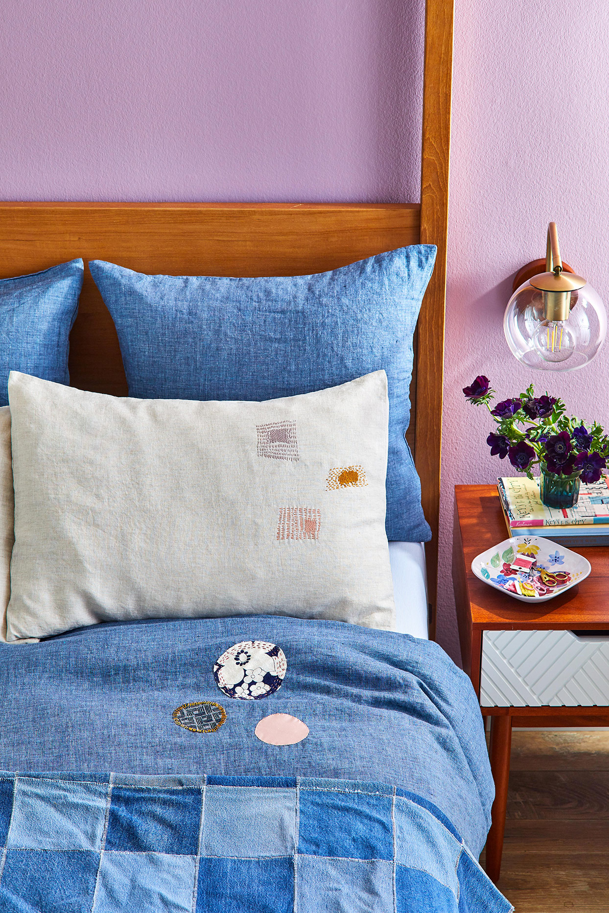 lavender bedroom with quilted blue bed spread