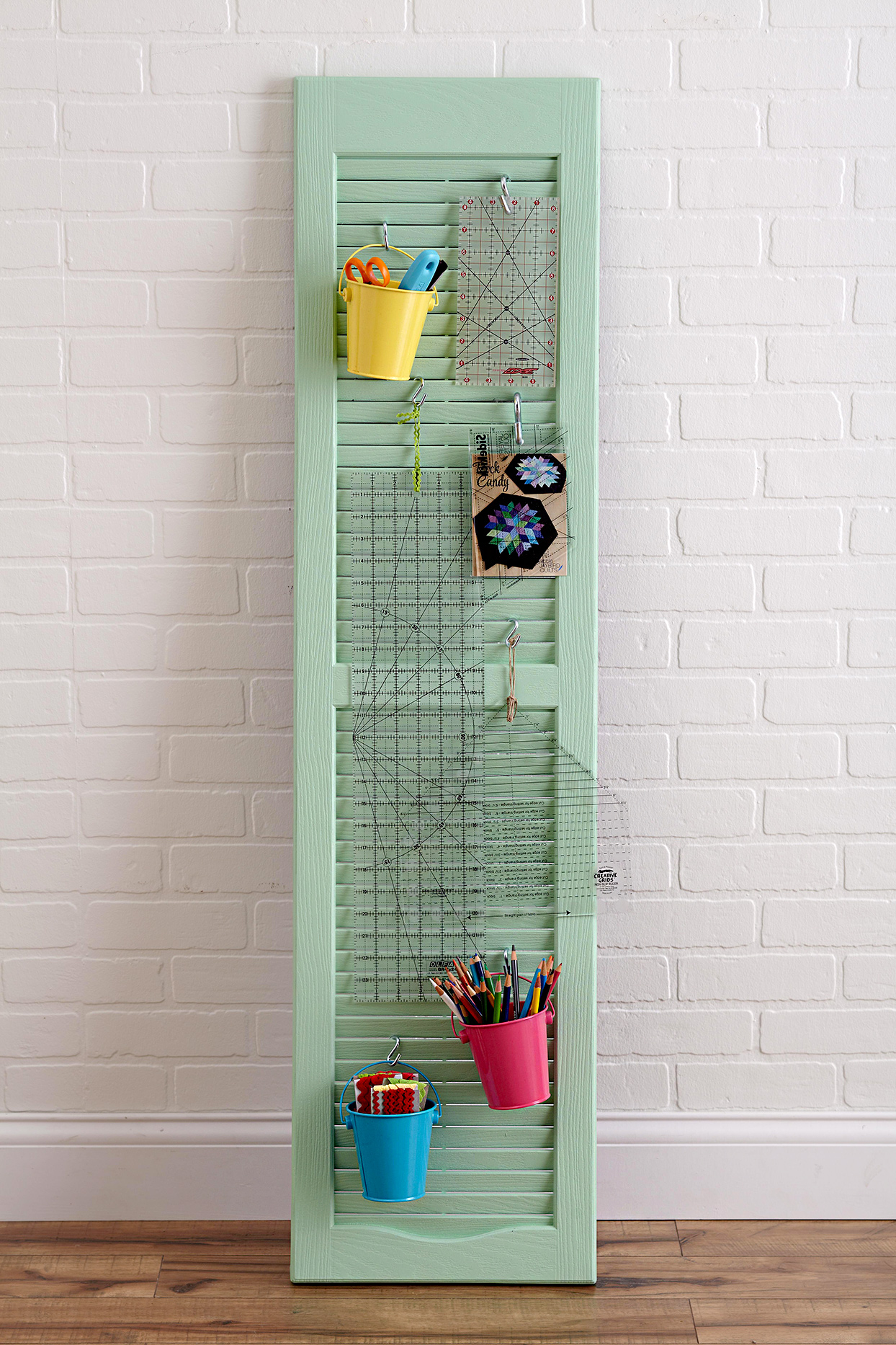 Light green shutter with hanging items