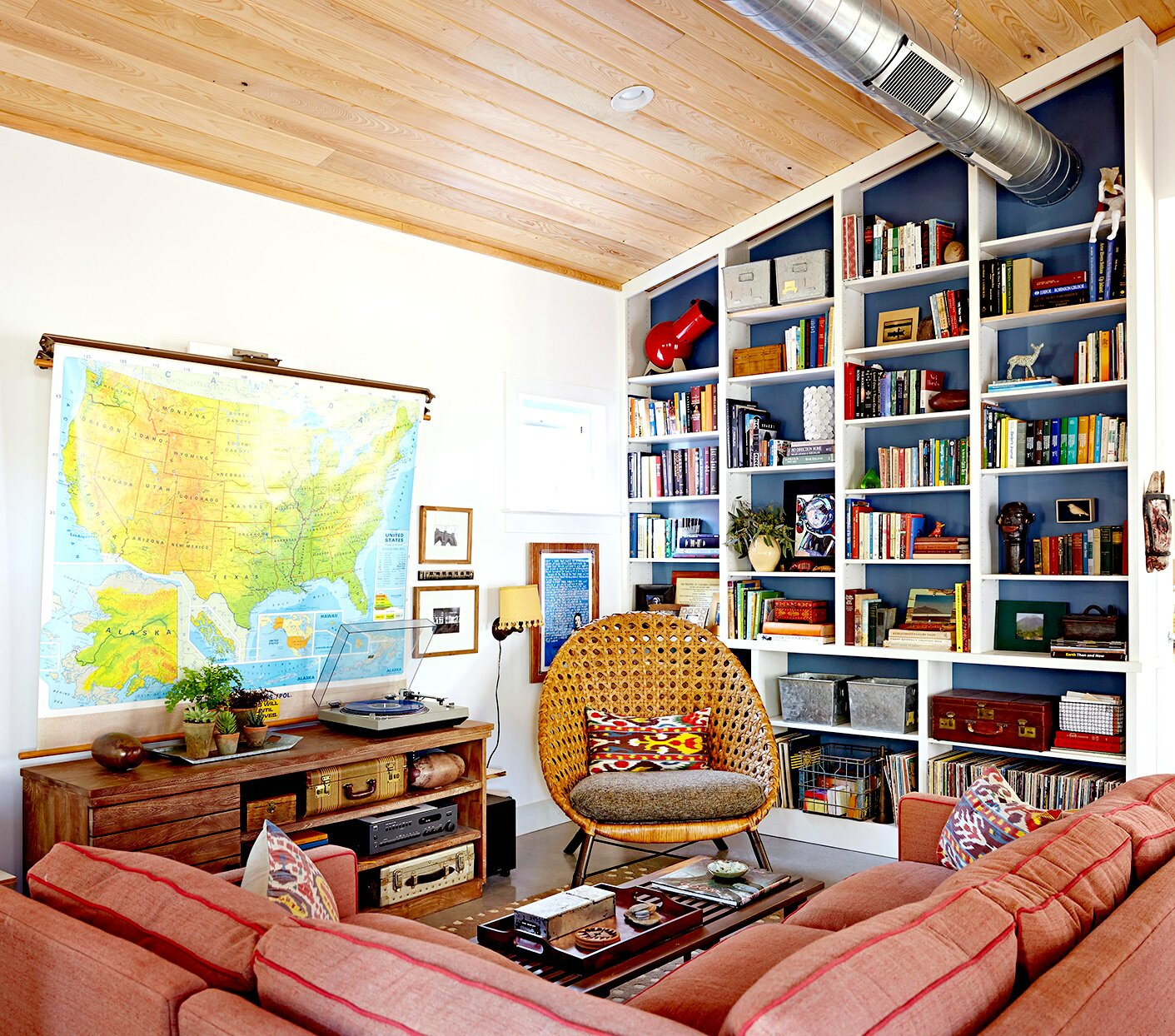 Living room with bookshelves and large USA map