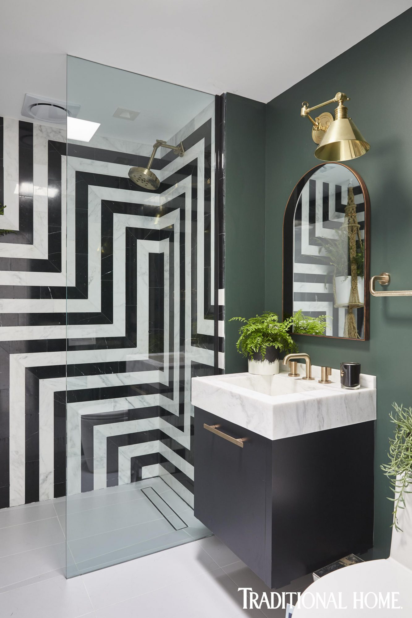 midcentury modern bathroom with black dragon tile backsplash