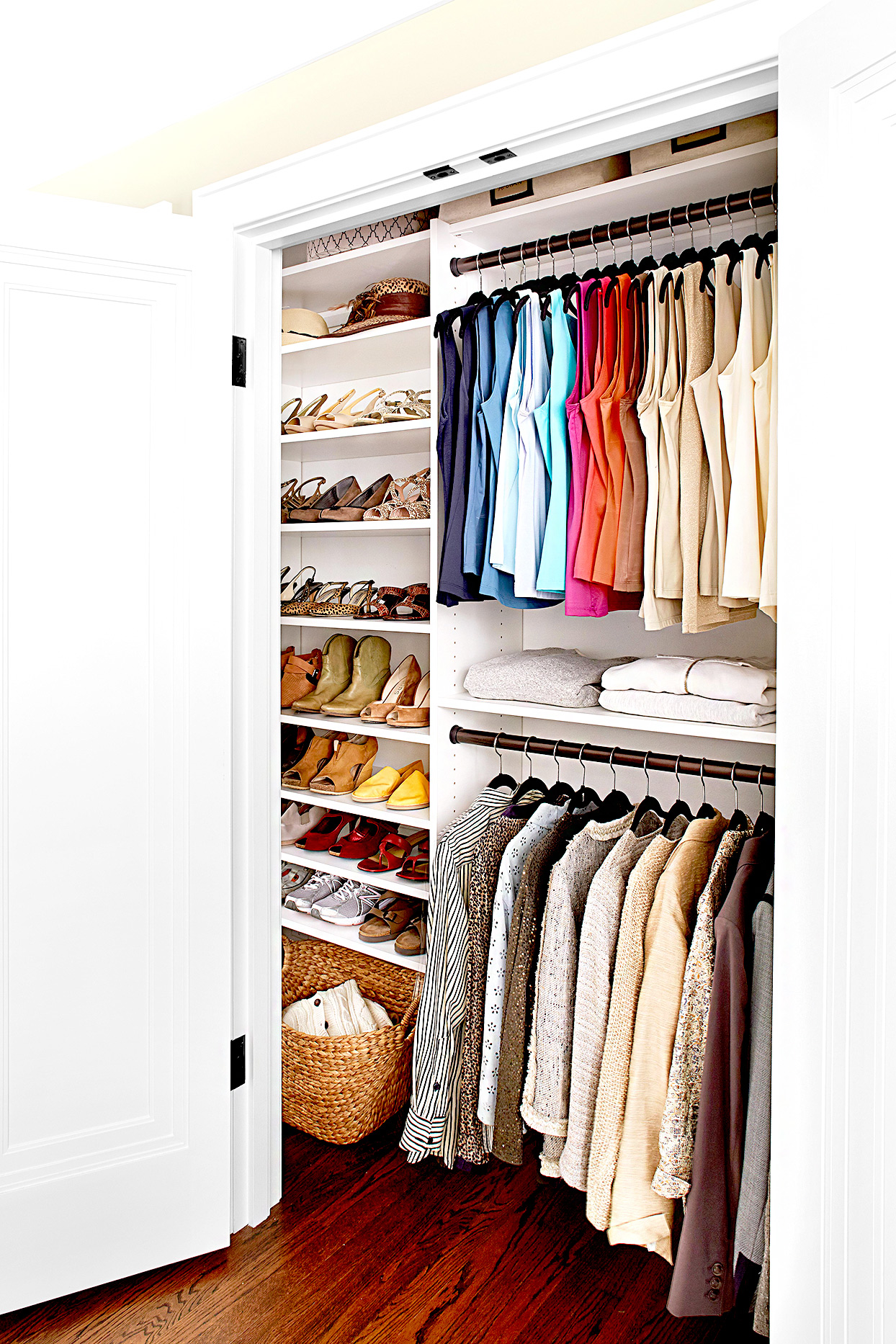 Organized closet with jackets, shirts, and shoes