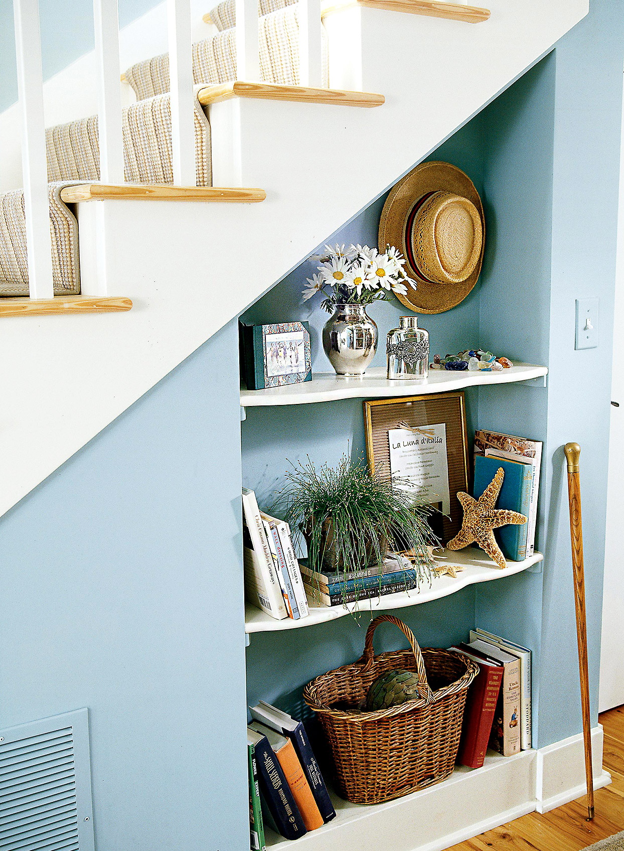 Shelves under stairs with décor