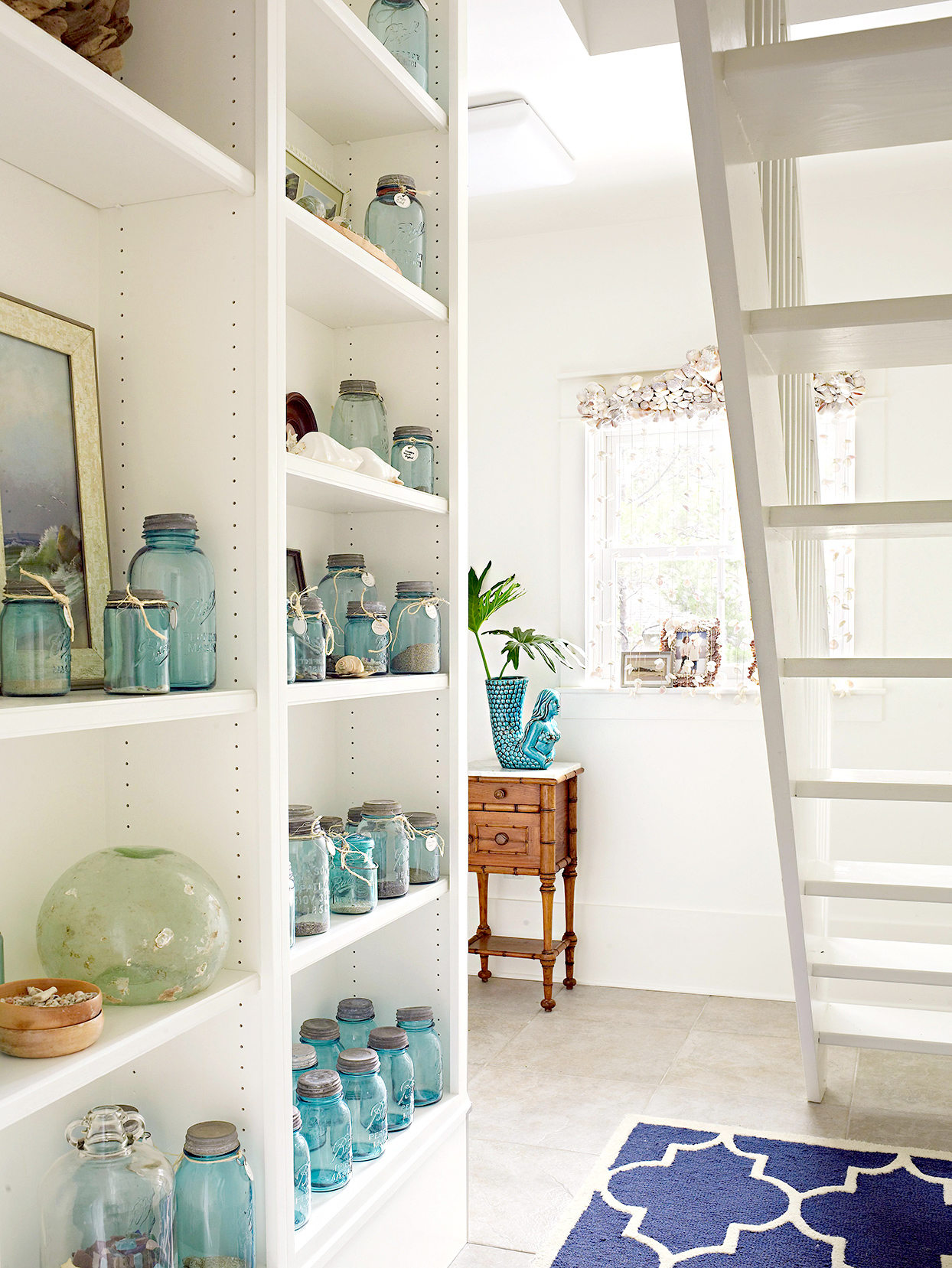 Shelving under stairs with décor