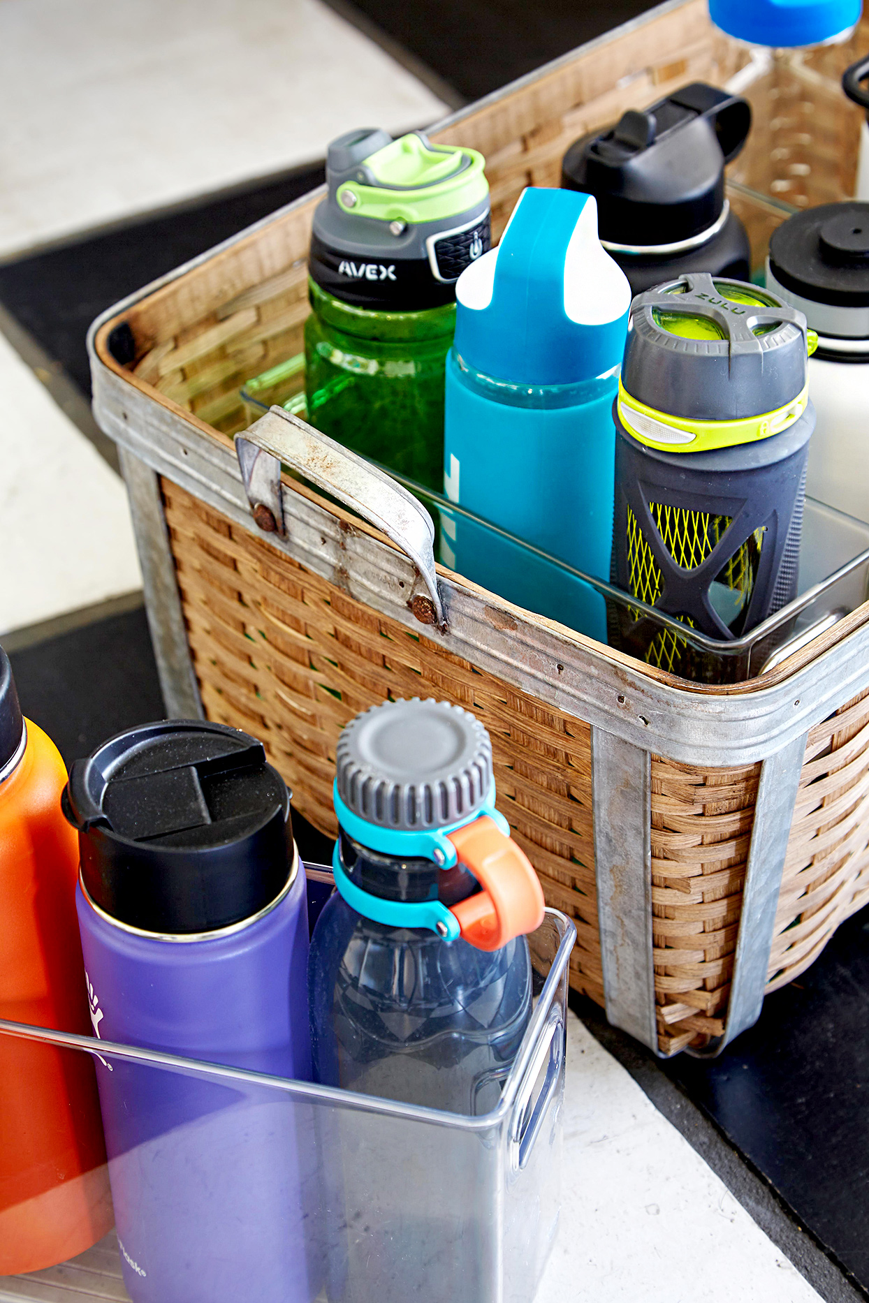Water bottles in plastic and wicker baskets