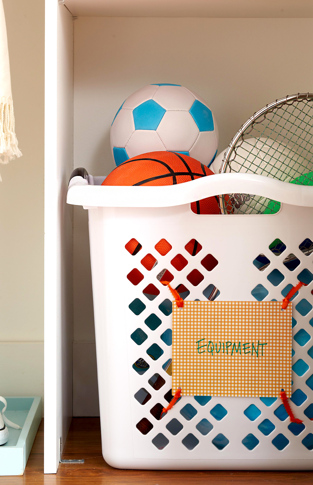 White basket filled with sports equipment