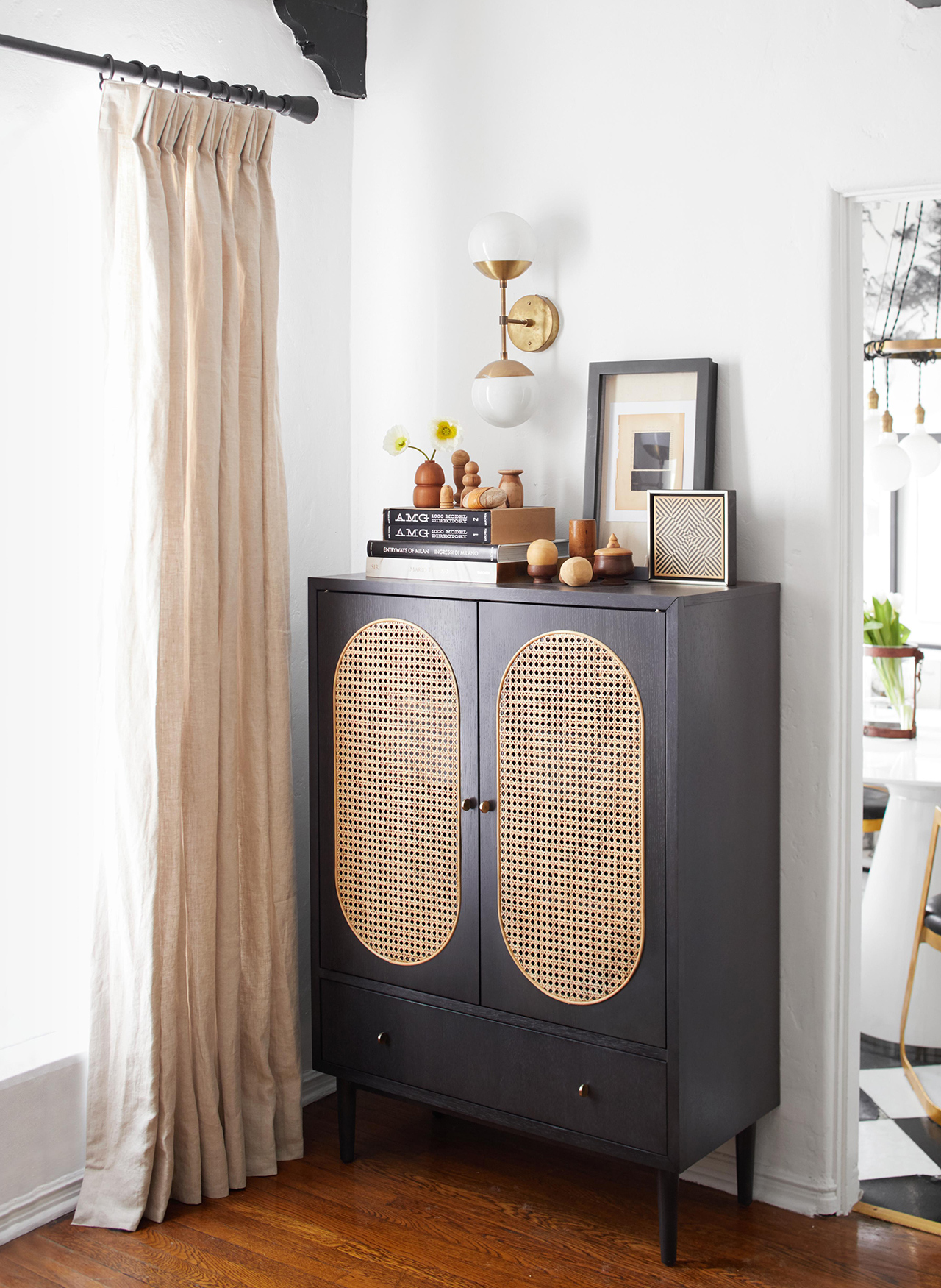 bar cabinet with woven caning on doors