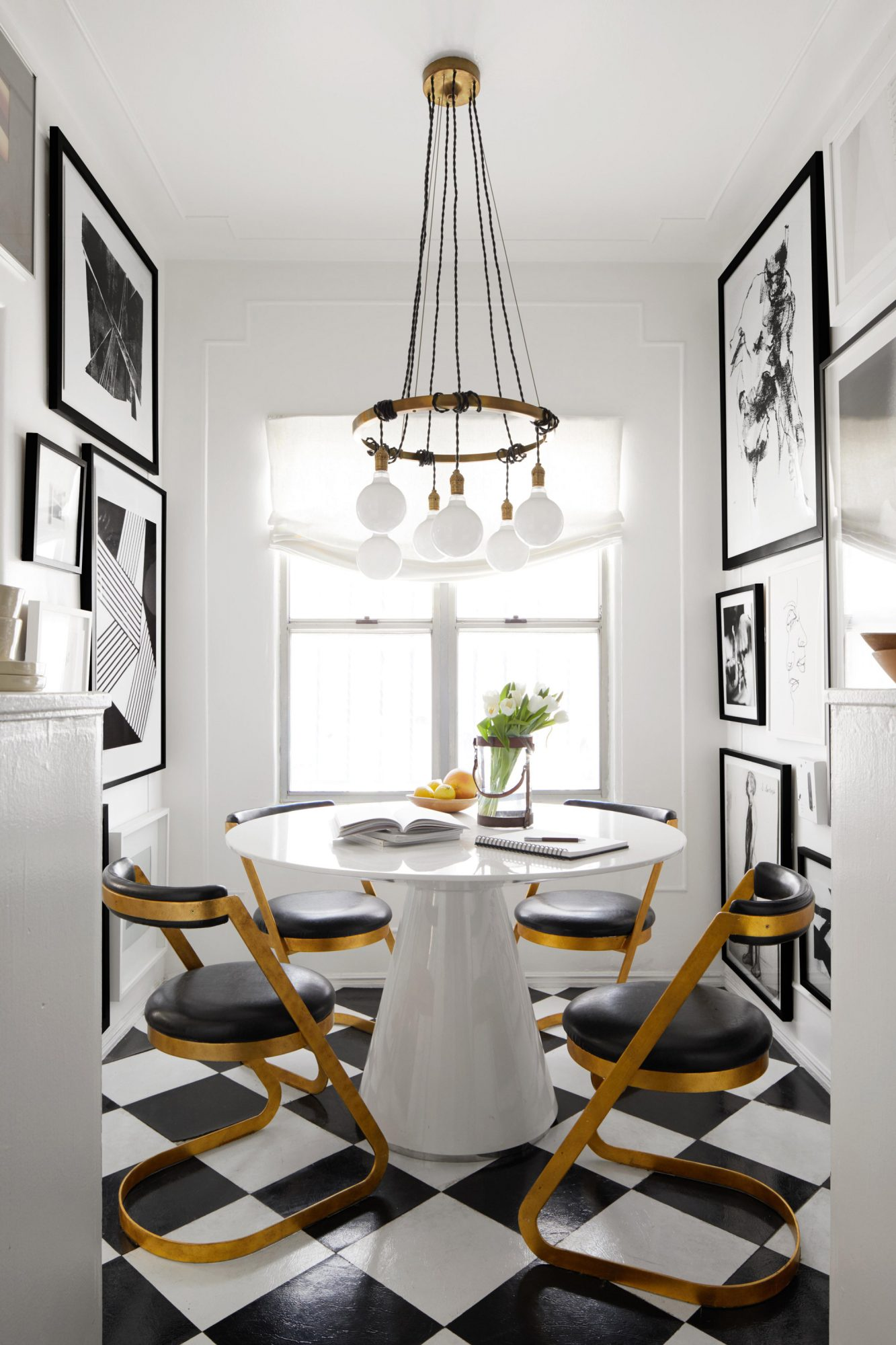 small white breakfast nook with black and white checkered floor