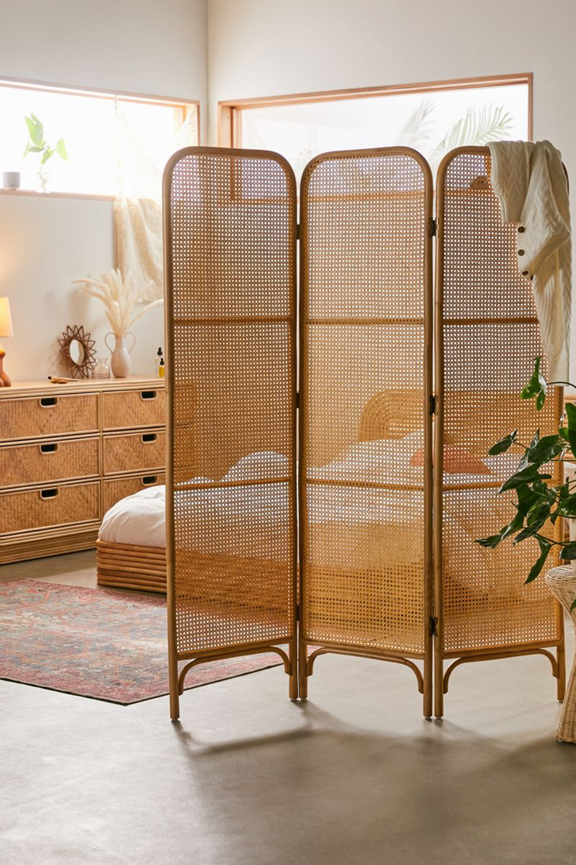 cane and rattan room divider in bedroom