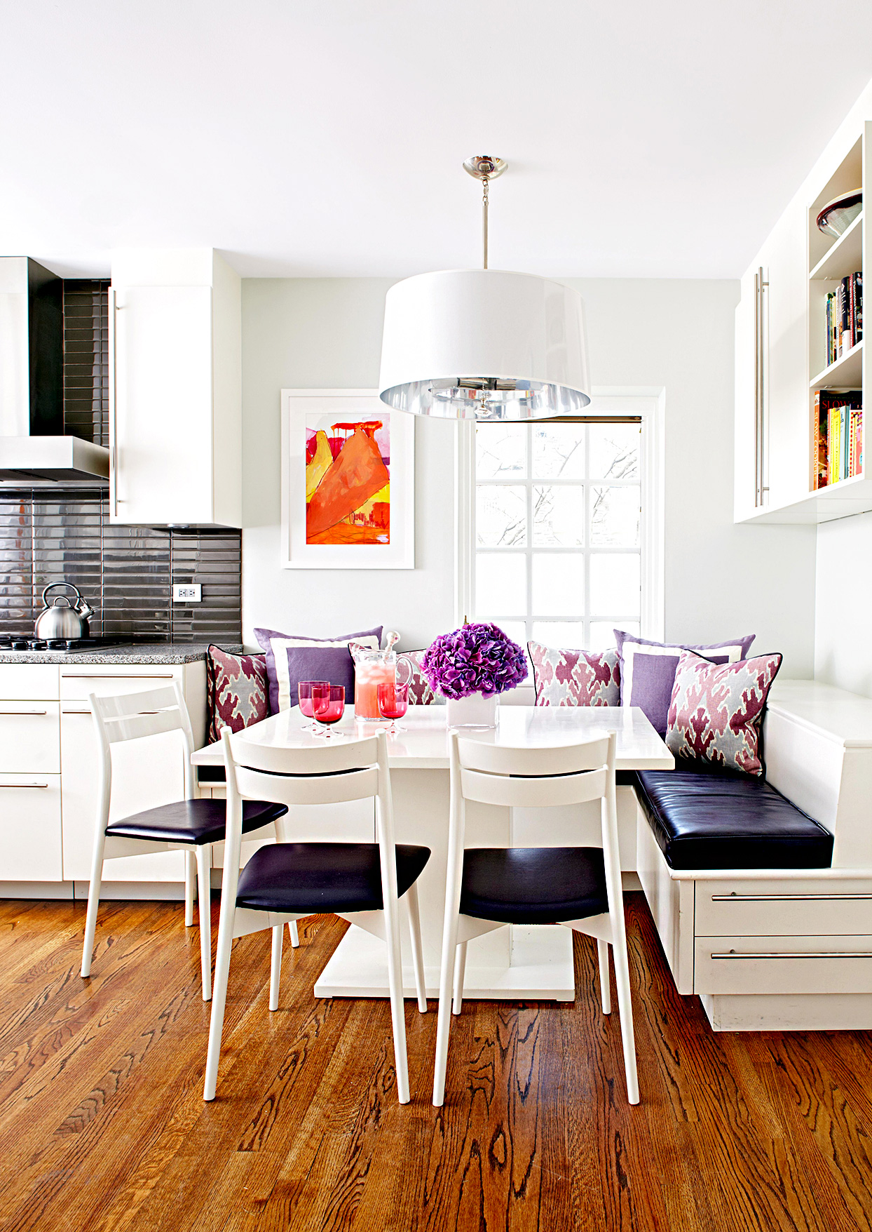 Corner dining area with booth seating and blue and white chairs