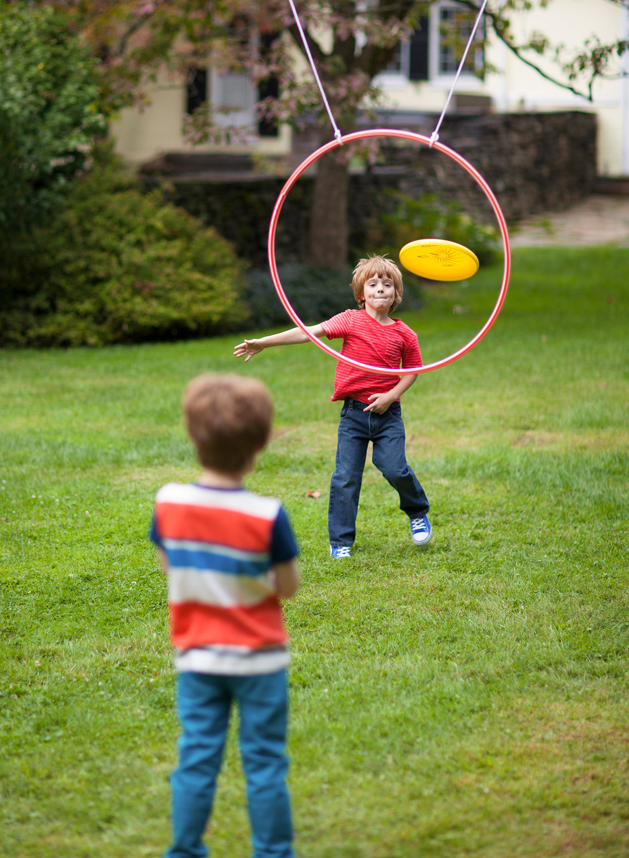 kids playing flying disc toss outdoors